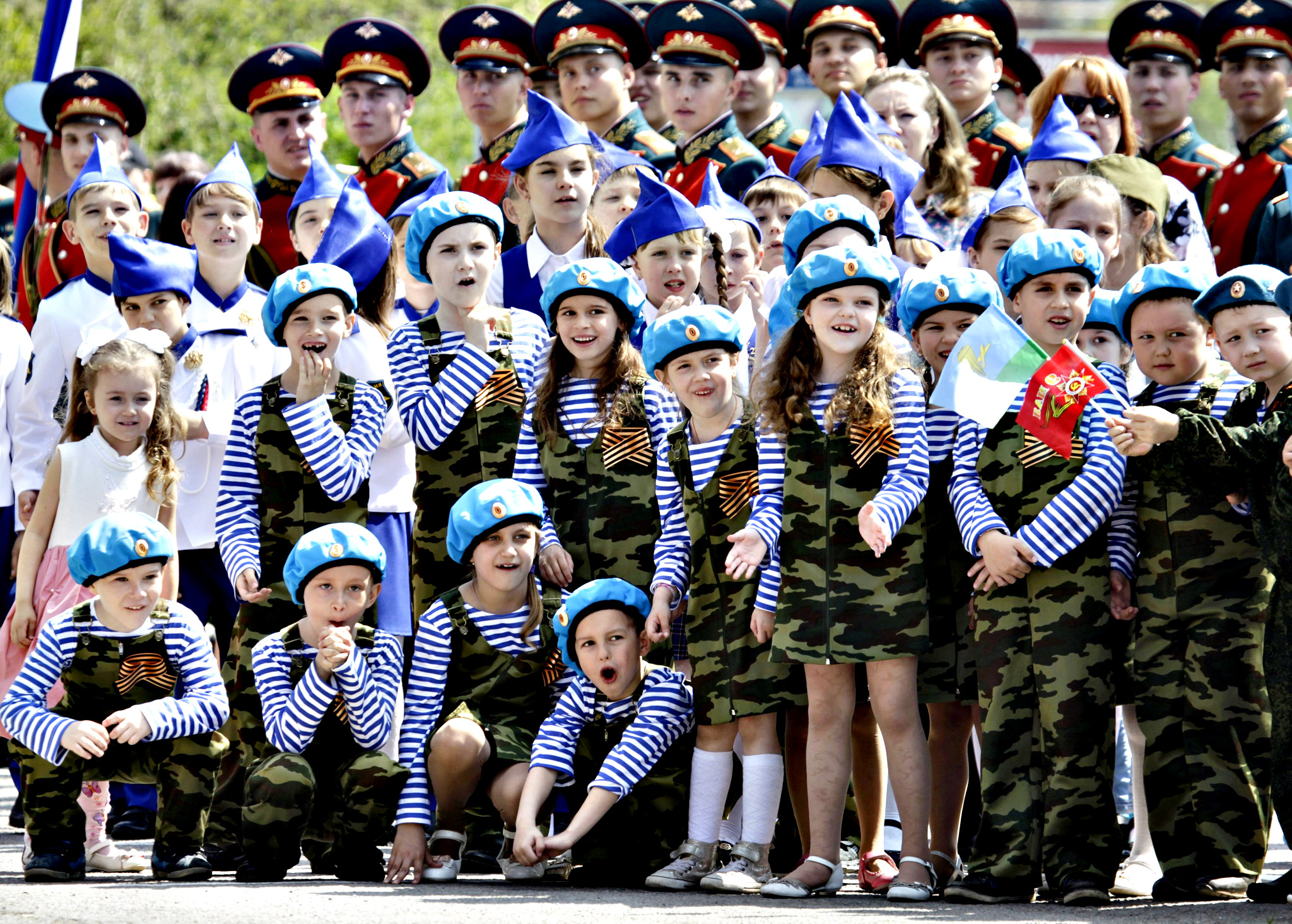 Children and honour guards watch a performance during the so-called parade of children's troops in Rostov-on-Don, southern Russia, on Thursday