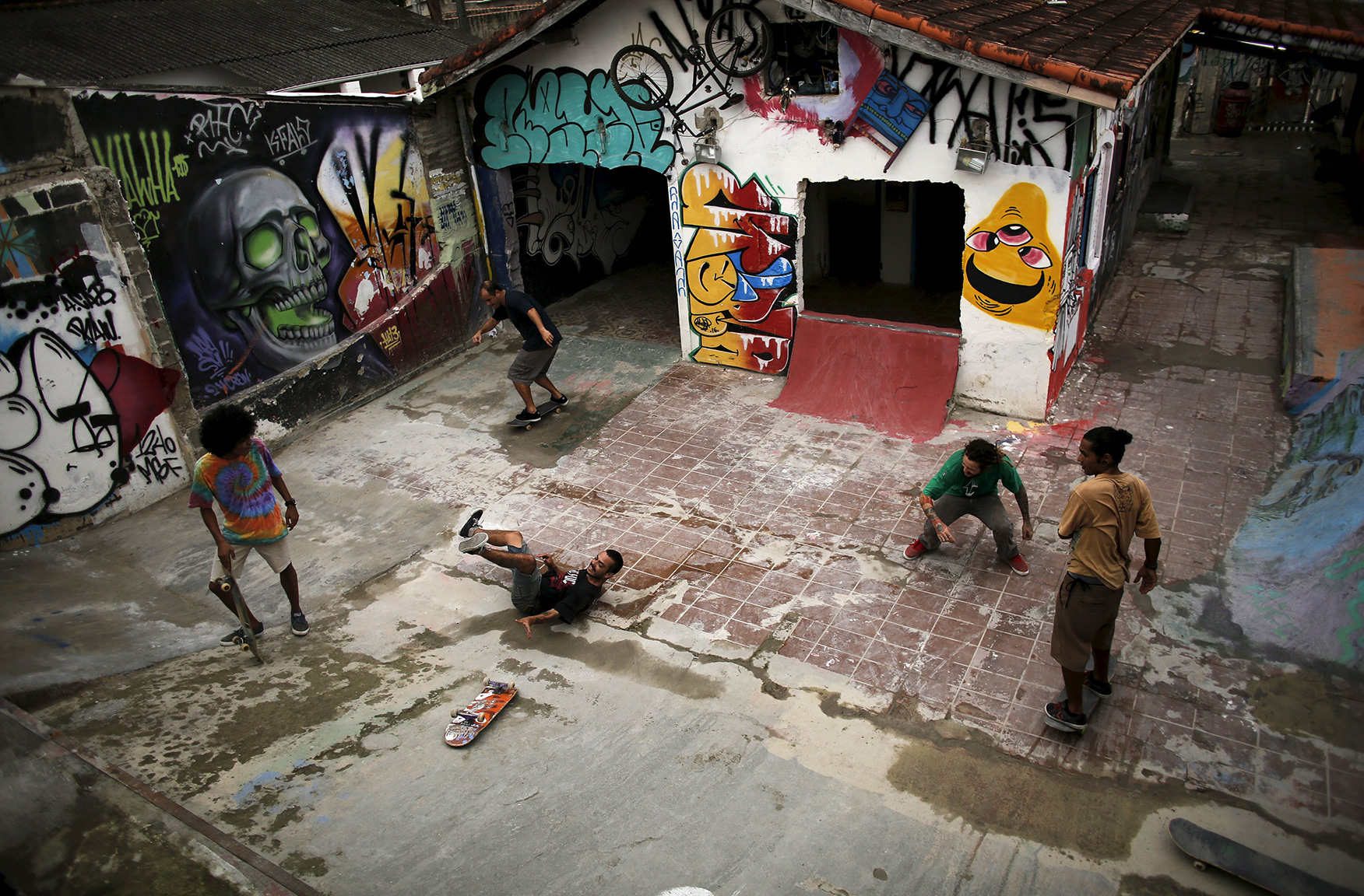 Skateboarders ride their boards in skate park house in Itanhaem