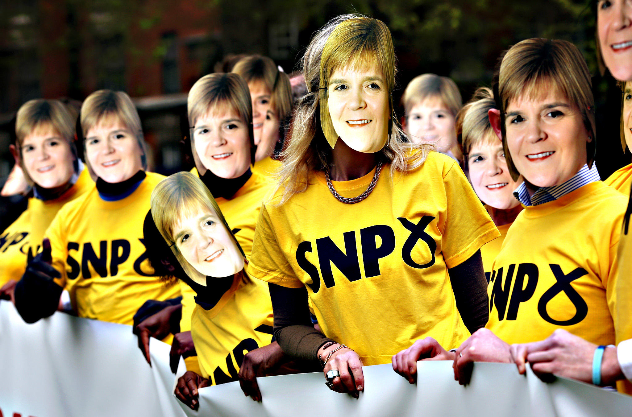 Conservative Party supporters wear Nicola Sturgeon masks during a photocall in Victoria Tower Gardens on Friday in London, England. The stunt was to warn of the risk of any possible coalition between the Labour Party and the SNP