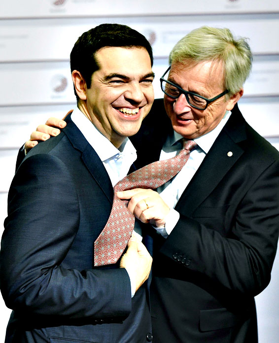 European Commission President Jean-Claude Juncker (R) makes a joke with tie-less Greek Prime Minister Alexis Tsipras (L) during the second day of the Eastern Partnership Summit in Riga, Latvia, 22 May 2015
