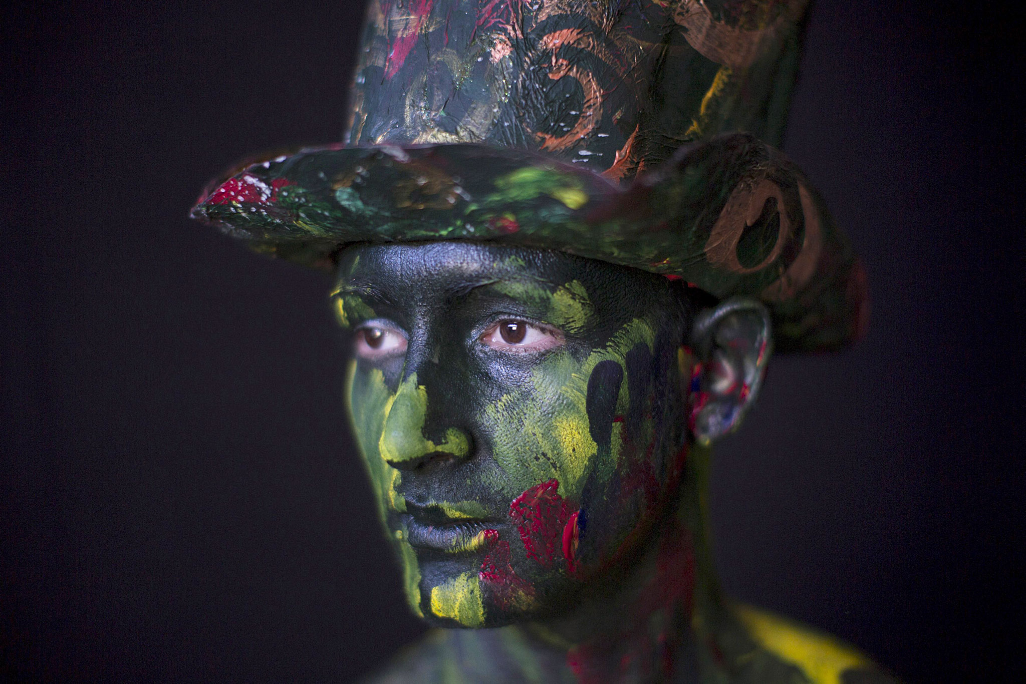 "Actor Orlando Silva, 25, poses for a photo as he has his body painted to perform as part of the creation ""Mutacion Forzada"", or Forced Mutation, by Cuban artist Alberto Lescay during the 12th Havana Biennial, in Havana...Actor Orlando Silva, 25, poses for a photo as he has his body painted to perform as part of the creation ""Mutacion Forzada"", or Forced Mutation, by Cuban artist Alberto Lescay during the 12th Havana Biennial, in Havana, May 31, 2015. REUTERS/Alexandre Meneghini"