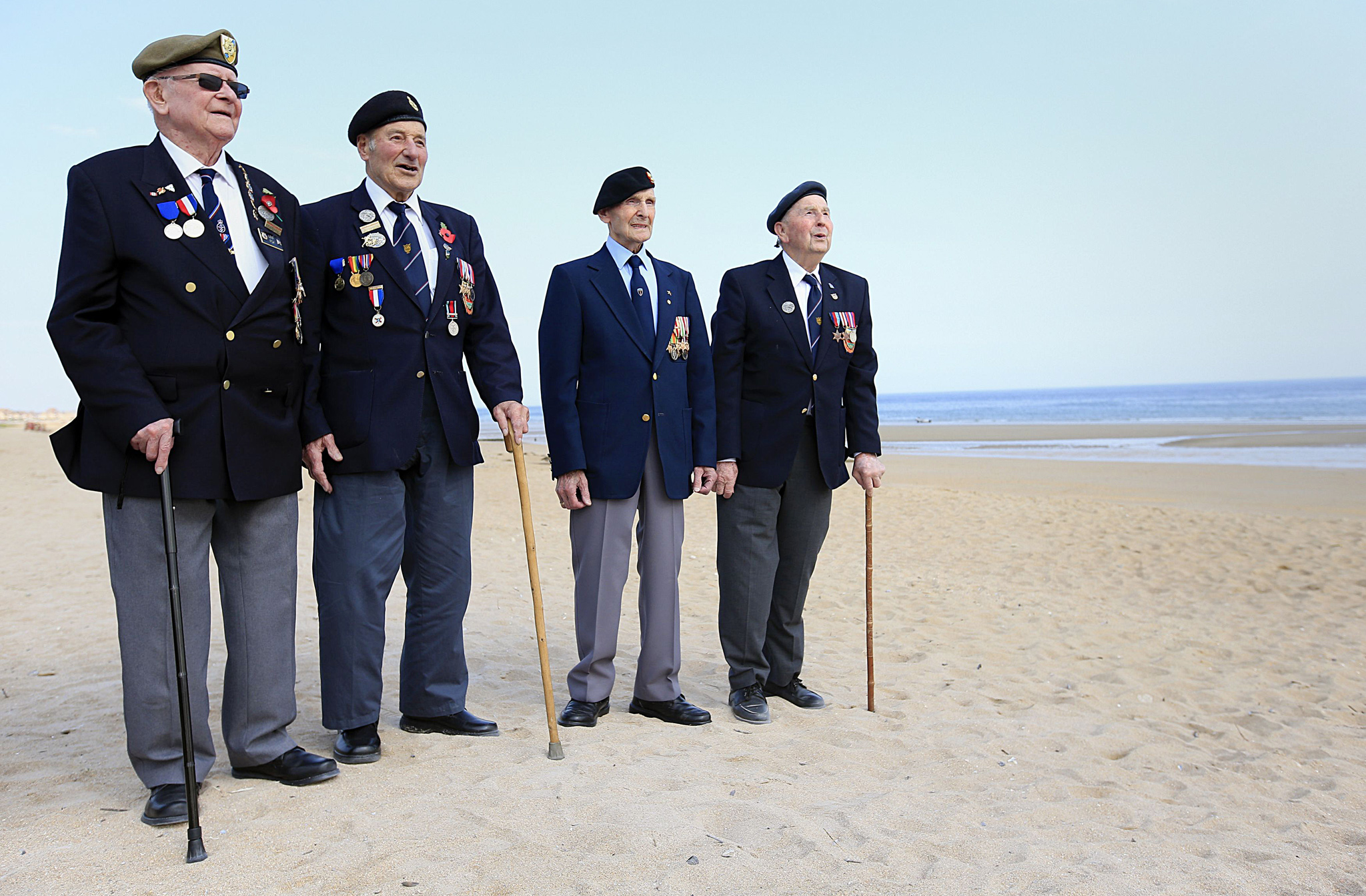 Veterans from the Norfolk and District branch of the Normandy Veterans Association (from the left) Len Fox, Peter Hemp, Neville Howell and David Woodrow stand on Sword beach in Normandy, France, as dozens of British veterans made a cross-Channel pilgrimage to Normandy to honour the legacy of comrades killed in the D-Day landings 71 years ago. PRESS ASSOCIATION Photo. Picture date: Friday June 5, 2015. Around 150 ex-servicemen have travelled to northern France to attend events commemorating the military invasion on June 6 1944 which changed the course of history, the Spirit of Normandy Trust said. See PA story MEMORIAL DDay. Photo credit should read: Jonathan Brady/PA Wire