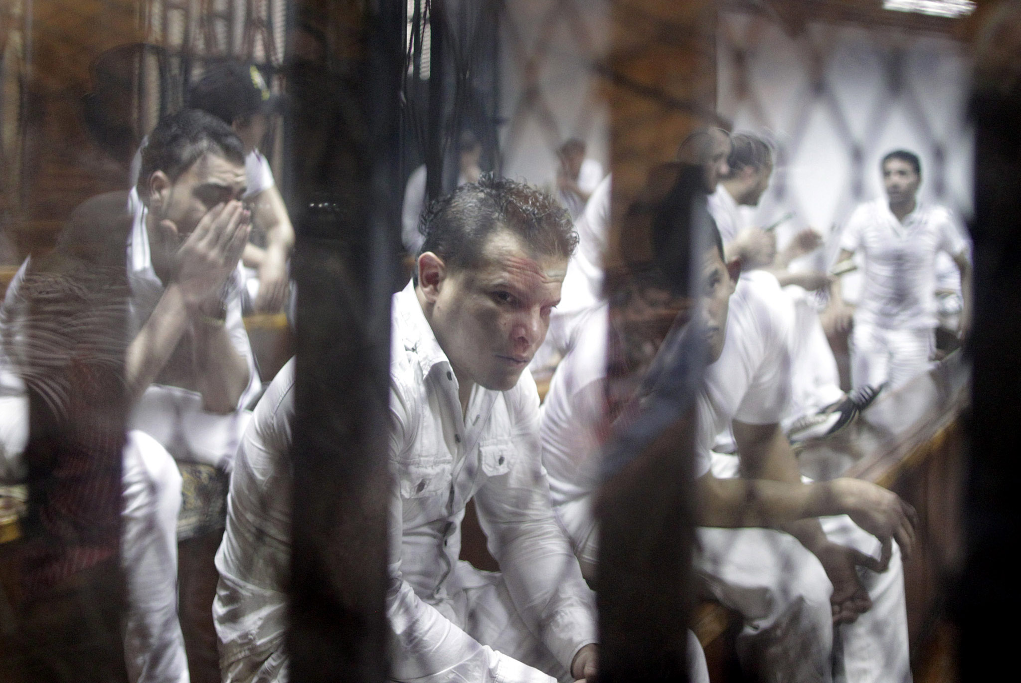 Egypt court sentences 11 to death over 2012 soccer riots...epaselect epa04790463 Defendants on trial for the deaths in a riot following a football match in Port Said in February 2012, stand behind bars during their trial in Cairo, Egypt, 09 June 2015. An Egyptian court on 09 June 2015 confirmed the death sentences of 11 men for their part in the country's worst-ever football-related violence. The 01 February 2012 riots left 74 dead after clashes between fans of Port Said's al-Masry team and visiting Cairo team al-Ahly. The sentences came at the end of a retrial after the country's top appeals court overturned a 2013 verdict in which 21 defendants were condemned to death.  EPA/KHALED ELFIQI