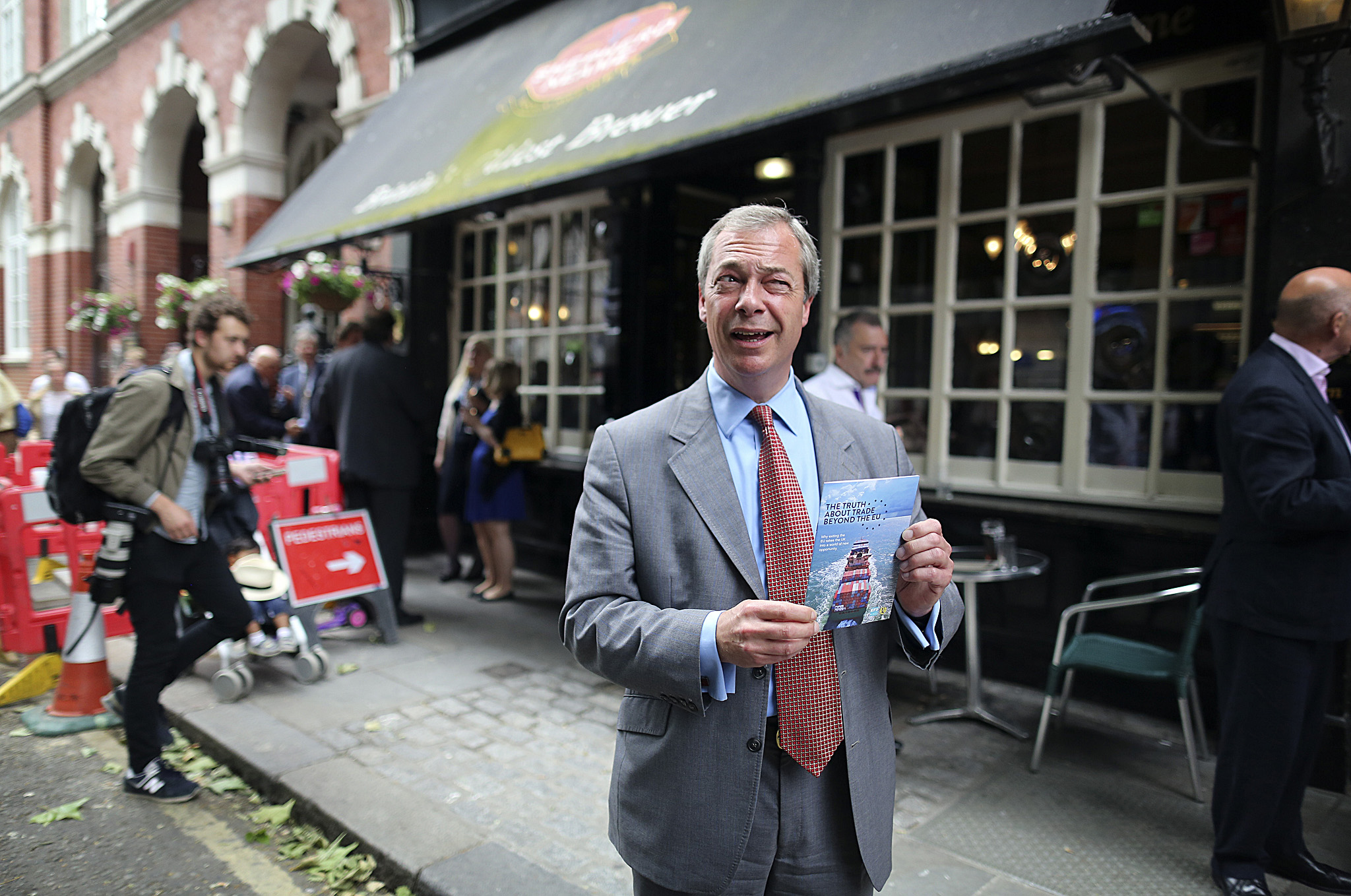 UKIP's leader, Nigel Farage, enjoys a pint of masterbrew in a pub in Westminster as UKIP launched their Euro referendum campaign.