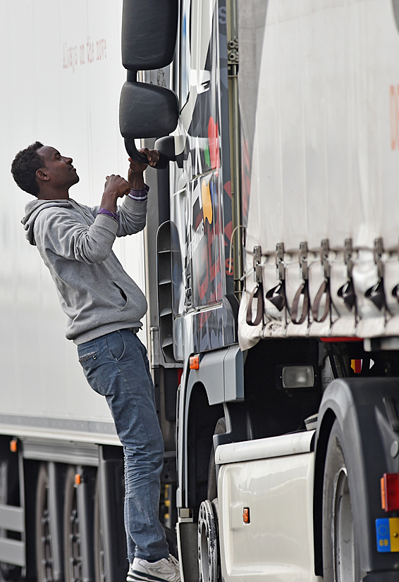 CALAIS, FRANCE - JUNE 26:  Migrants continue to try and board lorries bound for the United Kingdom on June 26, 2015 in Calais, France. Many migrants are camped in Calais on the side of the motorways as they attempt to board trucks stuck in slow moving traffic in the hope of making it into the UK.  (Photo by Jeff J Mitchell/Getty Images)