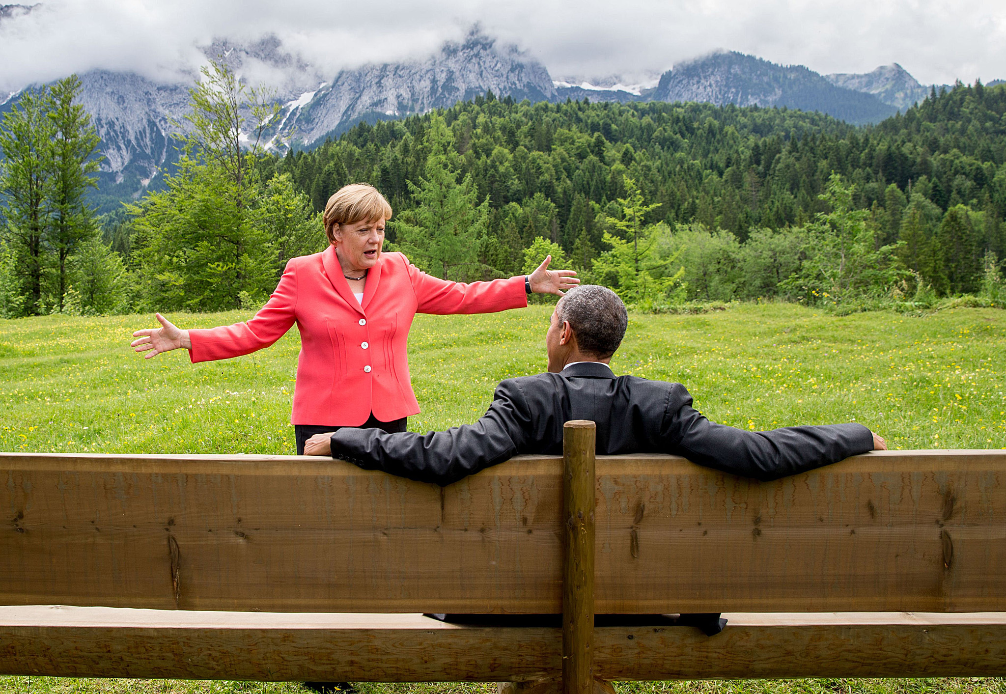 TOPSHOTS Germany's Chancellor Angela Mer...TOPSHOTS Germany's Chancellor Angela Merkel (L) gestures while chatting with US President  Barack Obama sitting on a bench outside the Elmau Castle after a working session of a G7 summit near Garmisch-Partenkirchen, southern Germany, on June 8, 2015. AFP PHOTO / POOL / MICHAEL KAPPELERMICHAEL KAPPELER/AFP/Getty Images