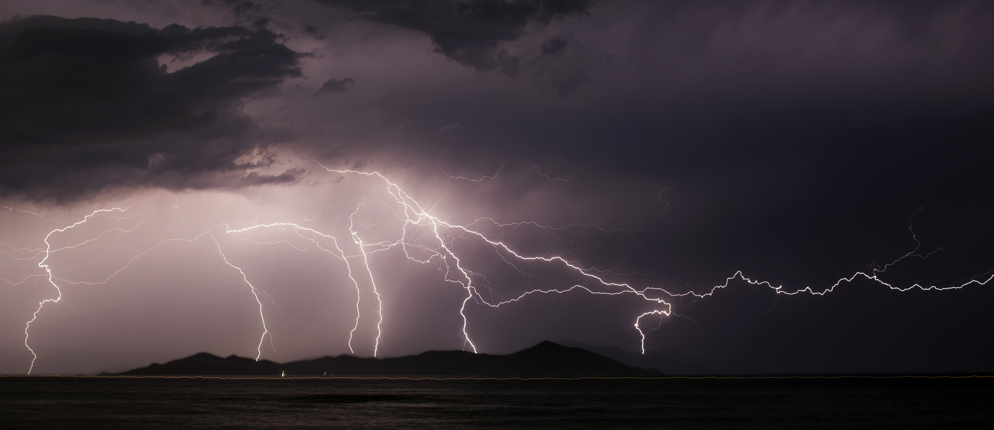 Migrants Continue To Arrive On Greek Island Of Kos...KOS, GREECE - JUNE 03:  Lightning strikes over the Greek Island of Pserimos on June 03, 2015 in Kos, Greece. Migrants are continuing to arrive on the Greek Island of Kos from Turkey who's shoreline lies approximately 5 Km away. Around 30,000 migrants have entered Greece so far in 2015, with the country calling for more help from its European Union counterparts.  (Photo by Dan Kitwood/Getty Images)