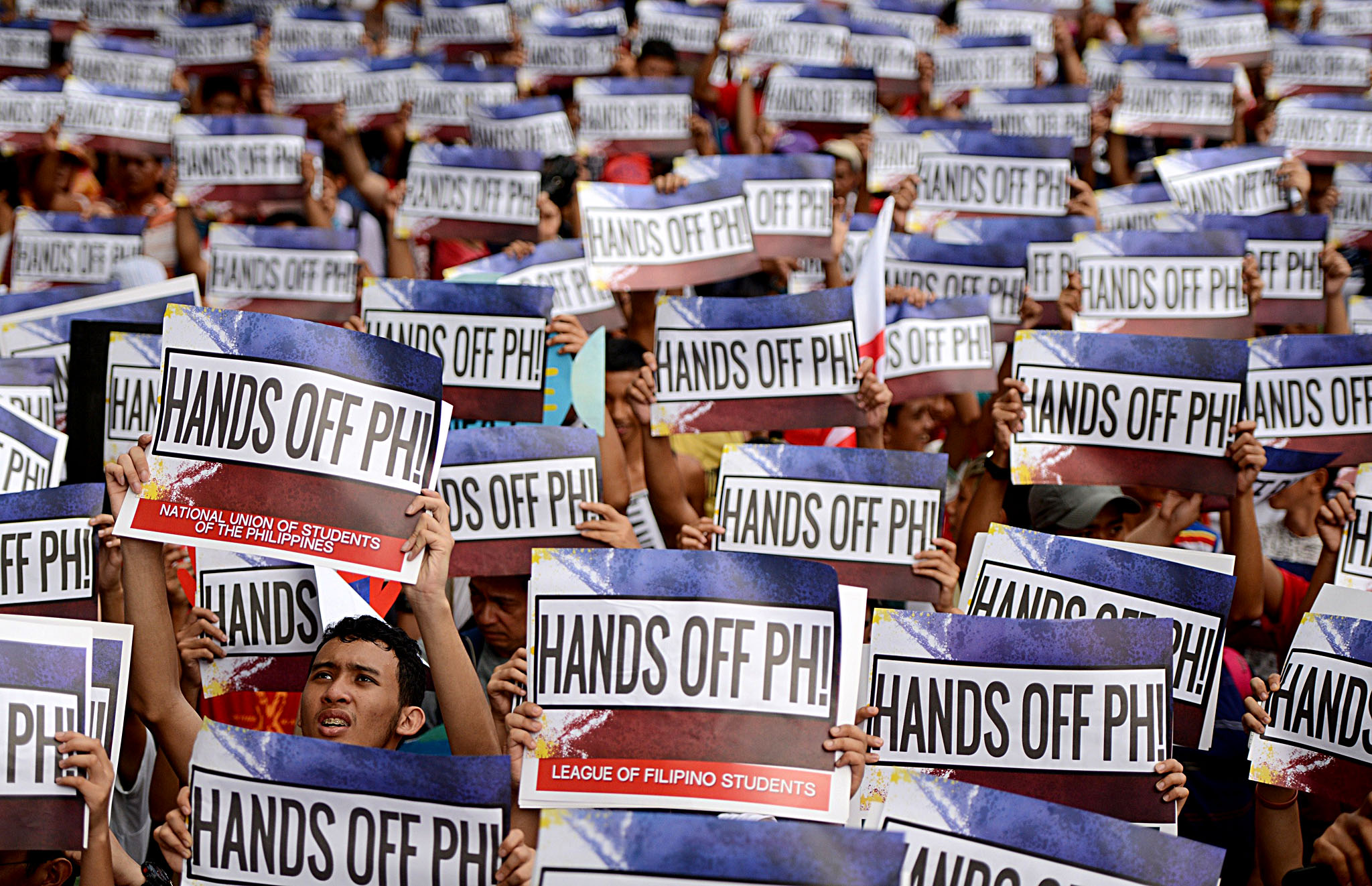 Activists hold a protest in front of the...Activists hold a protest in front of the Chinese Consular Office in Manila on June 12, 2015, as the country commemorates the 117th anniversary of the Philippines' declaration of independence from Spain. The protesters shouted slogans against China's reclamation and construction activities on islands and reefs in the Spratly Group of the South China Sea that are also claimed by the Philippines.  AFP PHOTO / NOEL CELISNOEL CELIS/AFP/Getty Images