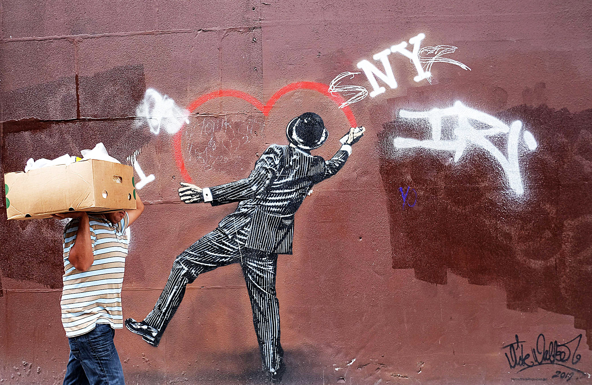 A man walks past street art in ...TOPSHOTS A man walks past street art in New York on June 23, 2015. AFP PHOTO/JEWEL SAMADJEWEL SAMAD/AFP/Getty Images
