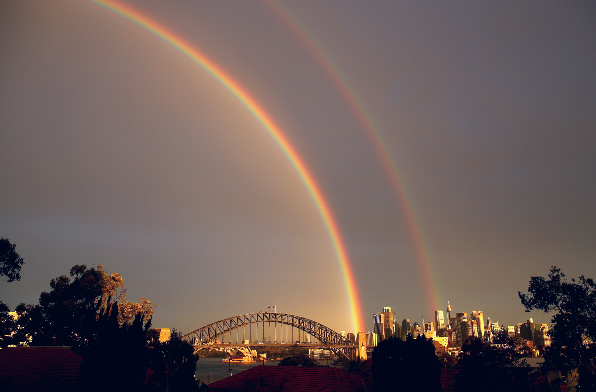 Rainbows Light Up Sydney Harbour...SYDNEY, AUSTRALIA - JUNE 17:  A rainbow is seen over the Sydney Harbour Bridge on June 17, 2015 in Sydney, Australia.  (Photo by Cameron Spencer/Getty Images)