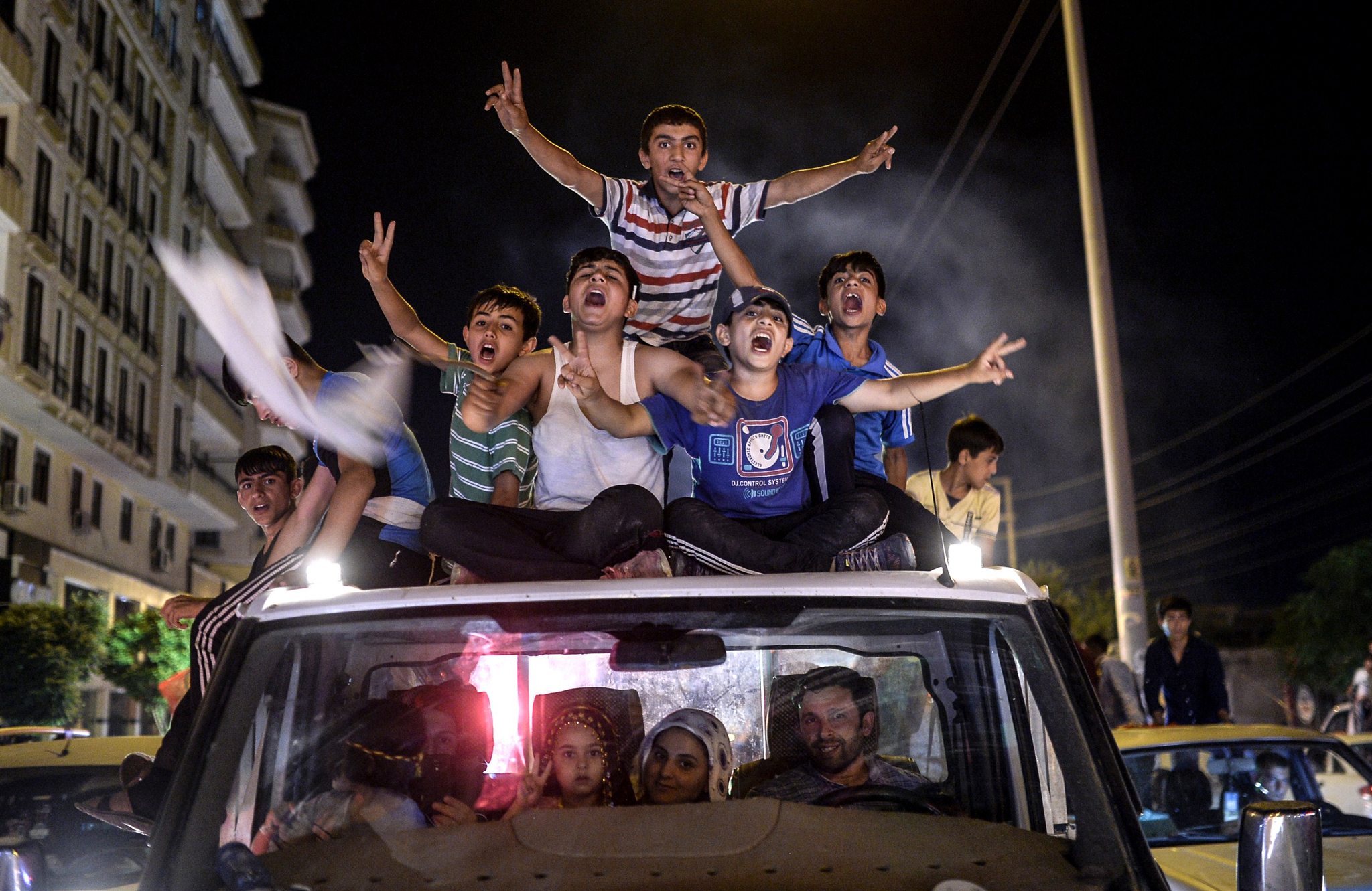 Young supporters of pro-Kurdish...TOPSHOTS Young supporters of pro-Kurdish Peoples' Democratic Party (HDP) celebrate in the streets the results of the legislative election, in Diyarbakir on June 7, 2015. The Turkey's Islamic-rooted Justice and Development Party (AKP) secured 41 percent of the vote, followed by the Republican People's Party (CHP) on 25 percent, the Nationalist Movement Party (MHP) on 16.5 and the pro-Kurdish People's Democratic Party (HDP) fourth on 12.5 percent. AFP PHOTO / BULENT KILICBULENT KILIC/AFP/Getty Images