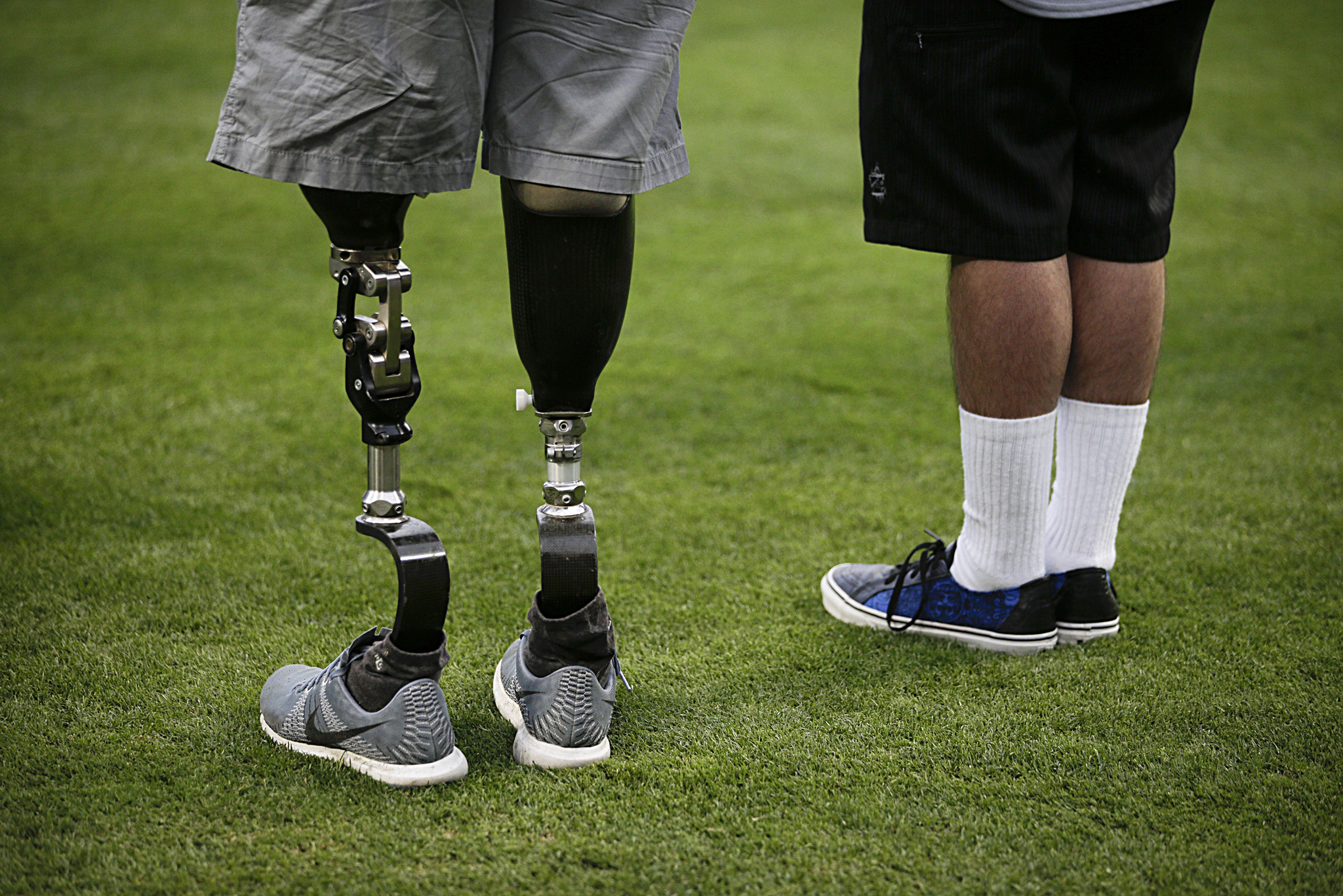 Wesley Barrientos...U.S. Army veteran Wesley Barrientos, left, who lost his legs in 2007 while serving in Iraq, listens to the national anthem before a baseball game between the Los Angeles Dodgers and the Arizona Diamondbacks, Tuesday, June 9, 2015, in Los Angeles. (AP Photo/Jae C. Hong)
