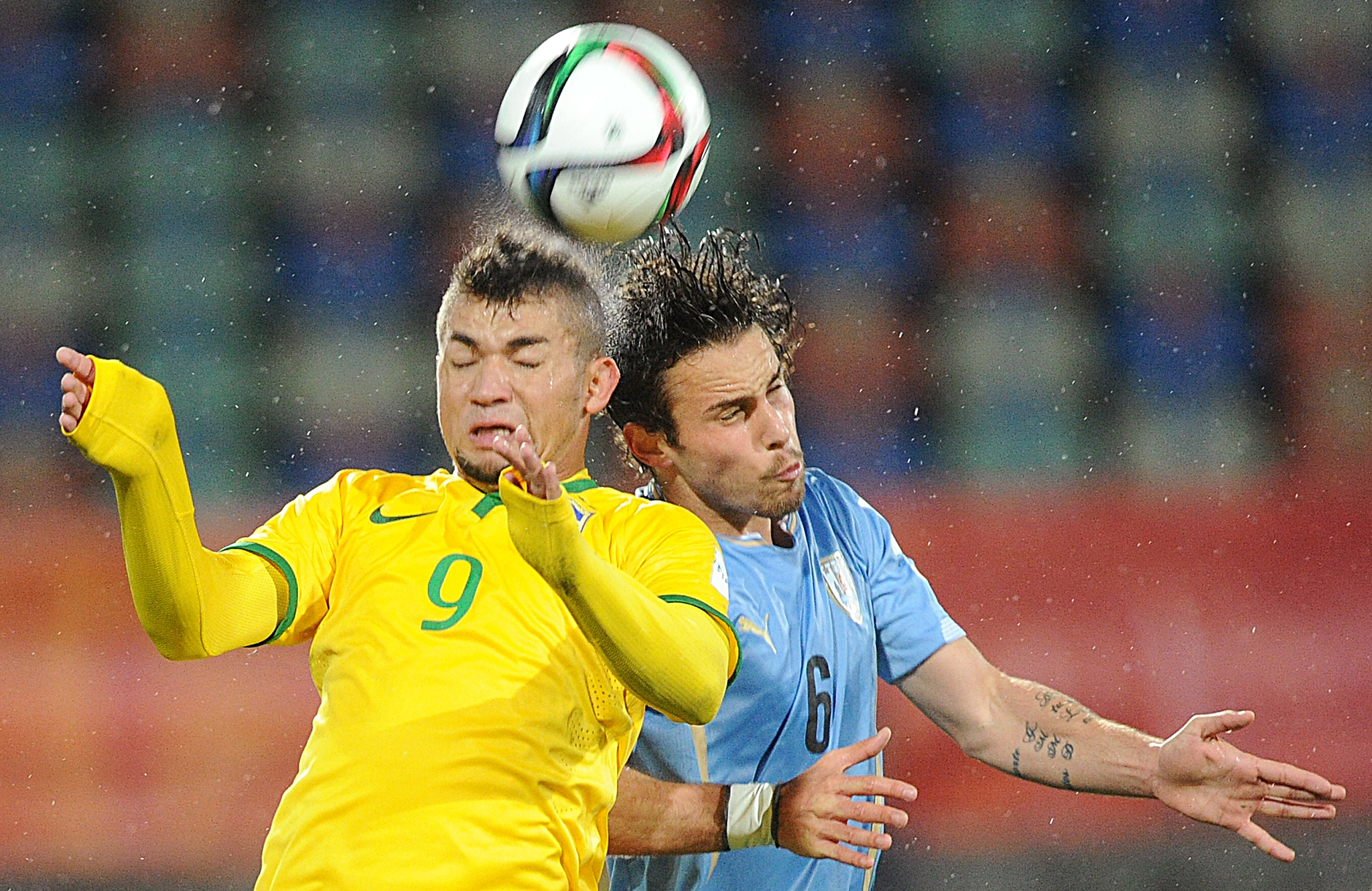 Brazil's Judivan, left, and Diego Poyet of Uruguay compete for a header during their U20 soccer World Cup match in New Plymouth, New Zealand, Thursday, June 11, 2015. (AP Photo/Ross Setford)