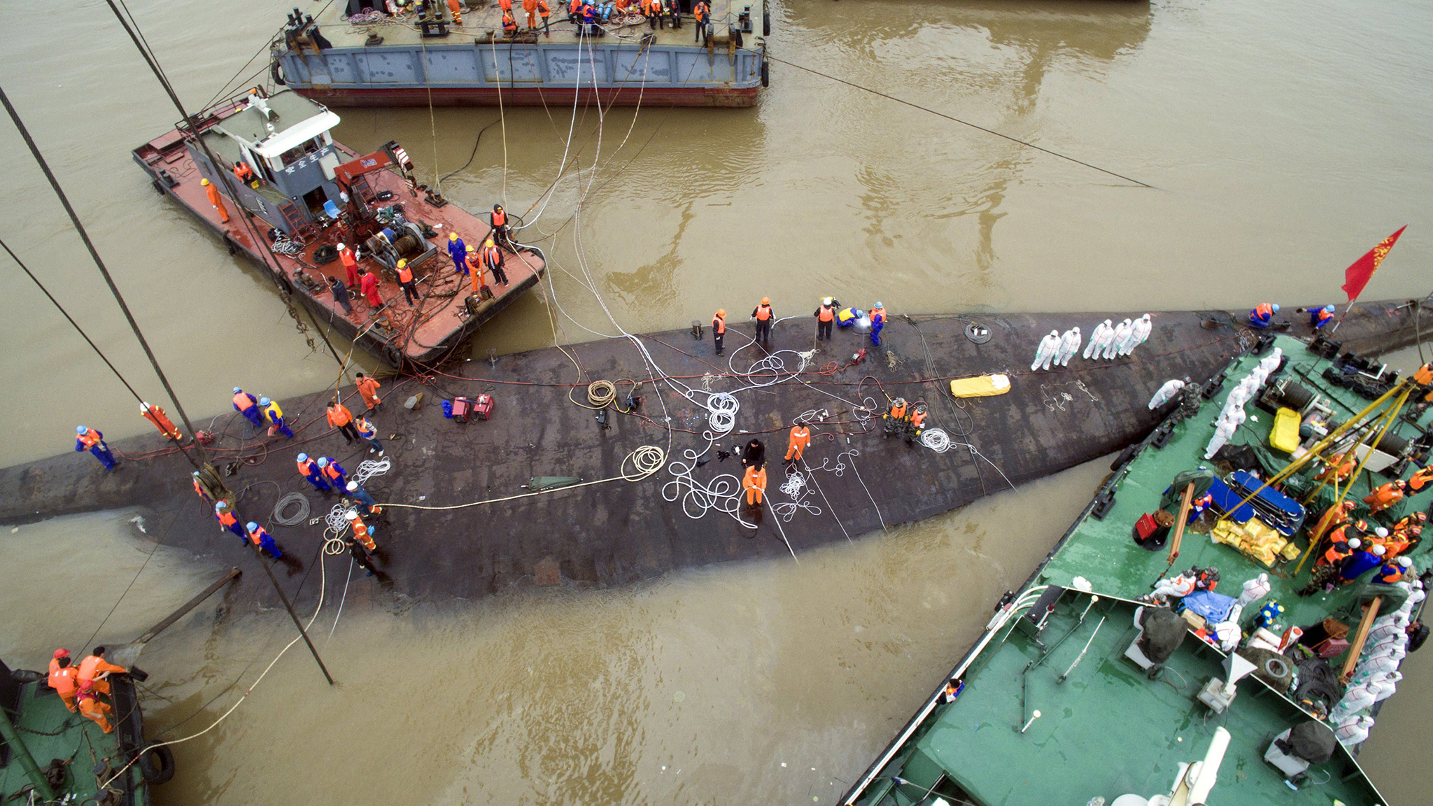 An aerial view shows rescue workers standing on the sunken cruise ship Eastern Star in Jianli