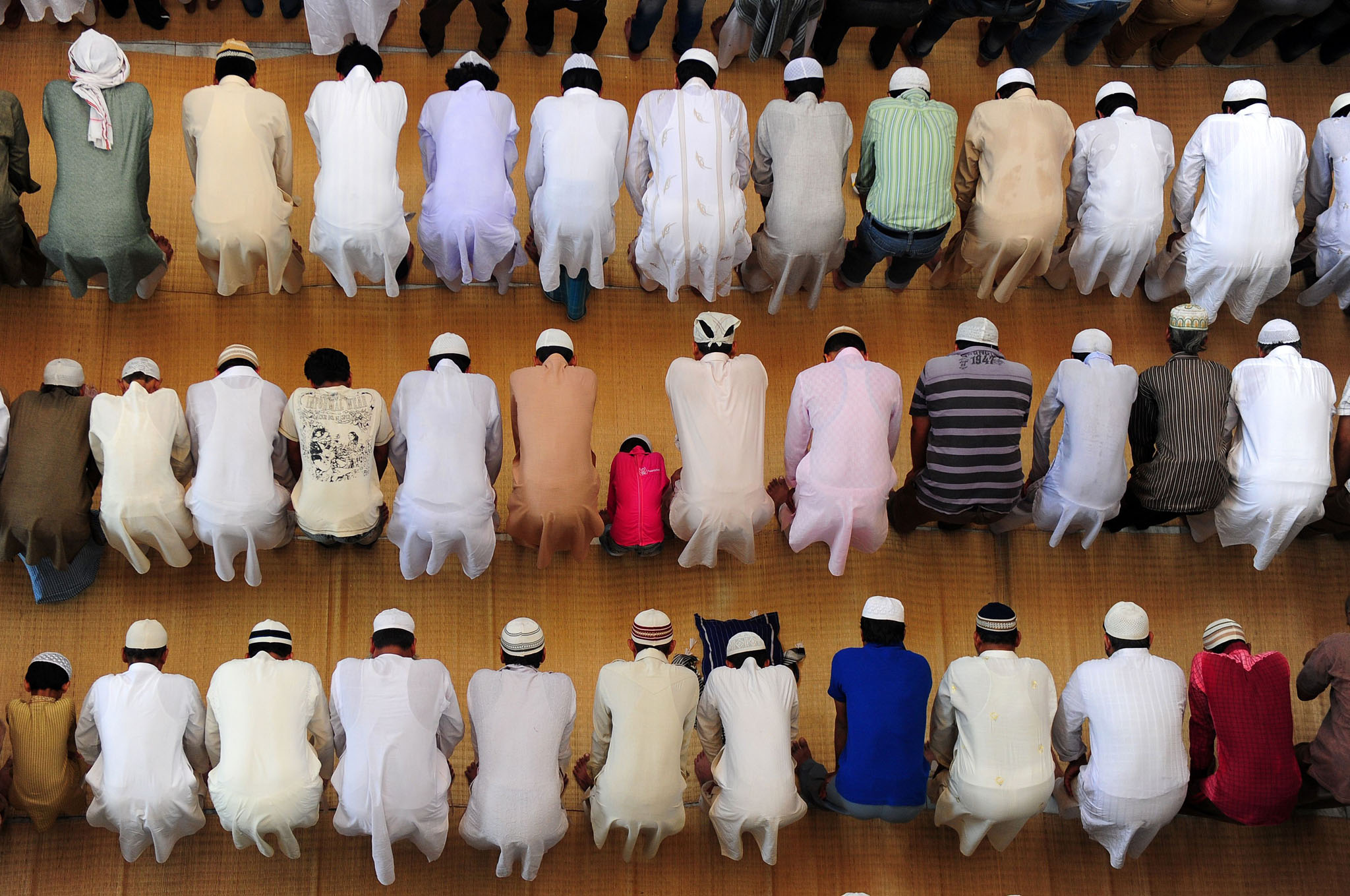 Indian Muslim devotees offer Friday prayers at the Vasi Ullah mosque on the first Friday of Ramadan in Allahabad.