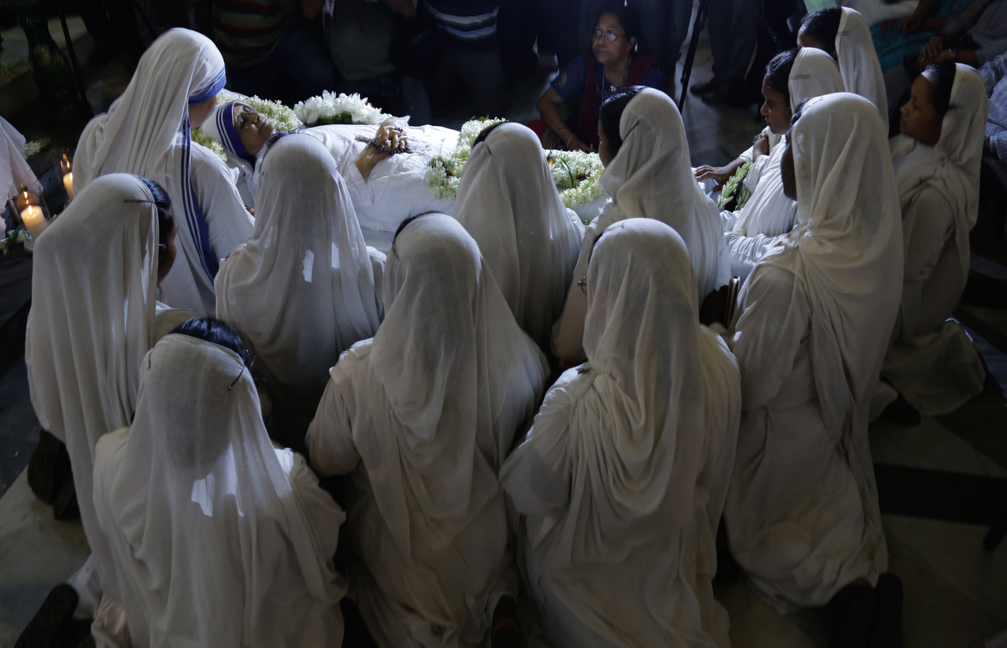 Nuns pray as they surround the body of Sister Nirmala Joshi, who succeeded Mother Theresa as the head of the Missionaries of Charity, in Kolkata, India.