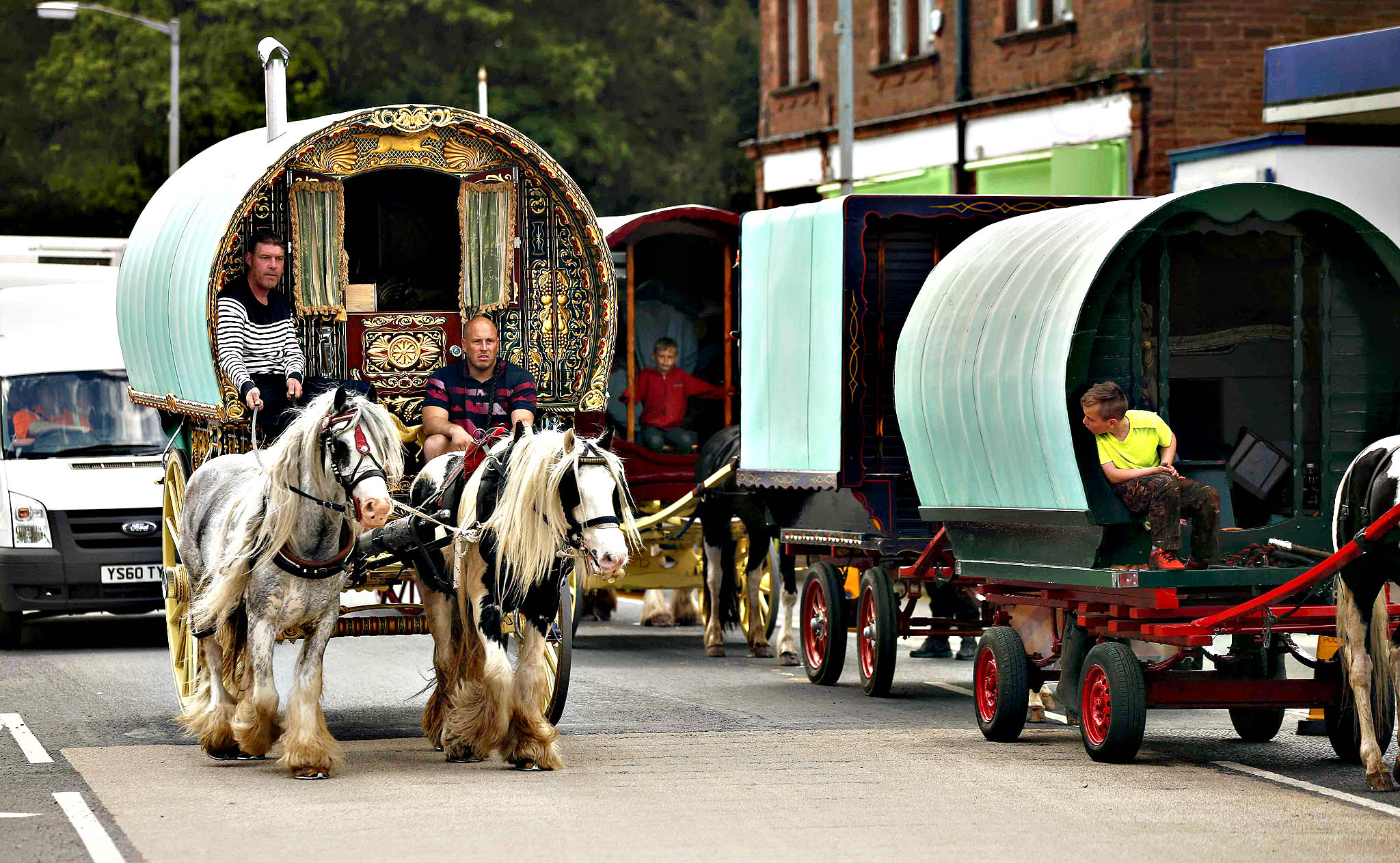 Travellers drive their traditional Romany caravans along the main road in Appleby in Westmorland, Britain June 4, 2015. The caravans form part of the annual horse fair which has taken place since the 1600's