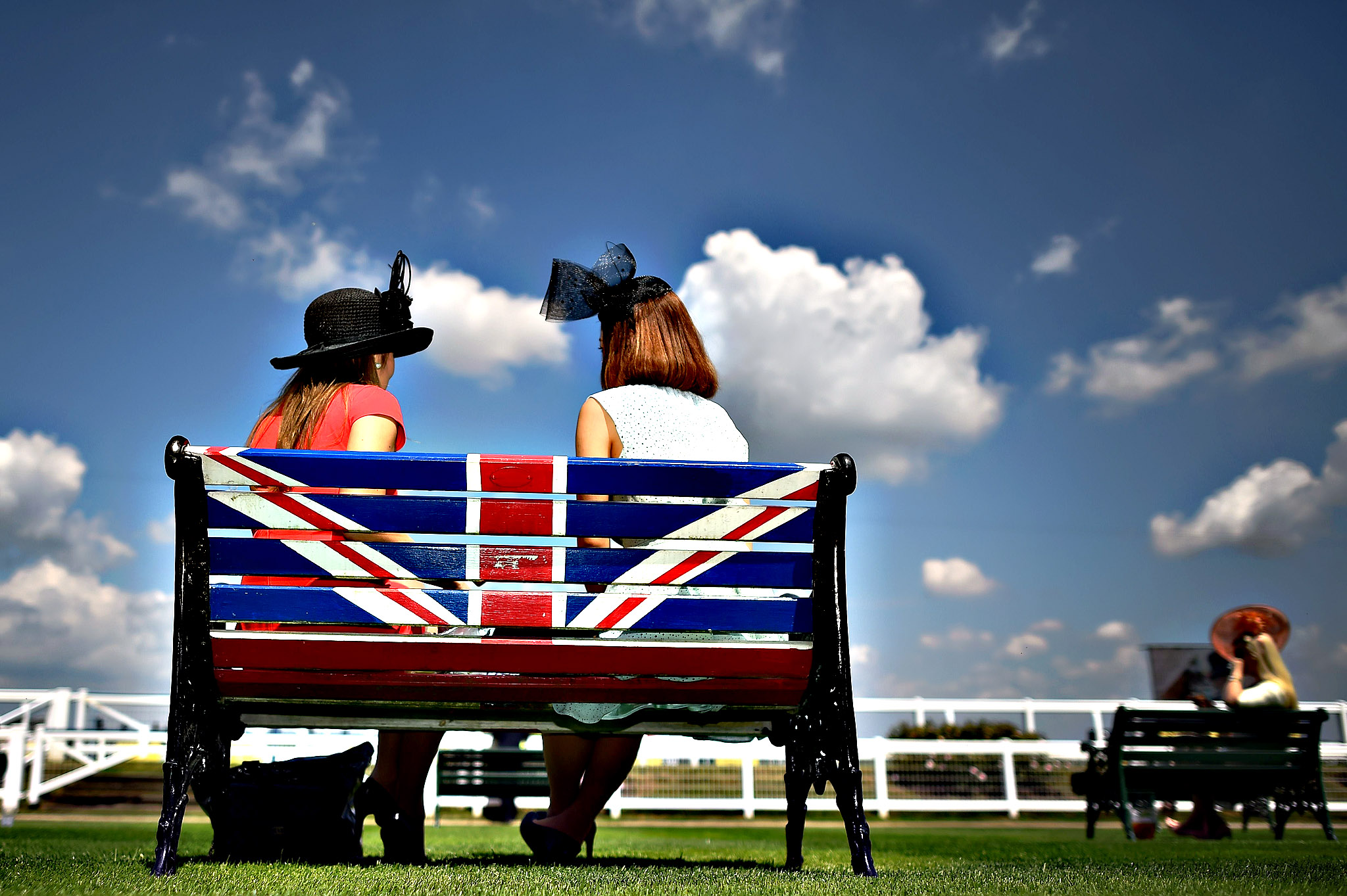 Race-goers relax on a bench displaying the Union Flag on the first day of the annual Royal Ascot horse racing event near Windsor, west of London, on June 16, 2015.