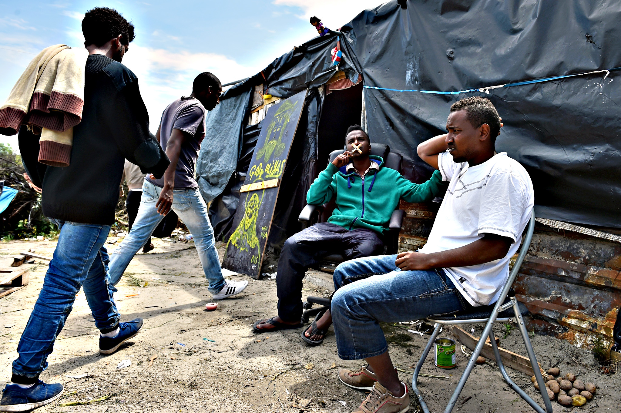 Migrants are seen in a make shift camp known as the 'New Jungle' on Thursday in Calais, France. Many migrants are camped in Calais on the side of the motorways as they attempt to board trucks stuck in slow moving traffic in the hope of making it into the UK