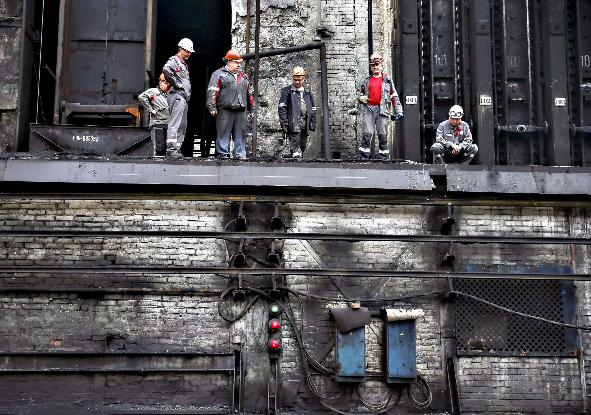 Workers are seen at a coke plant in the town of Avdiyivka near Donetsk, eastern Ukraine. Situated close to the 'contact line' between Ukrainian government forces and well-armed rebels, the Avdiyivka Coking Plant outside the rebel-held regional capital, Donetsk, has been hit by about 230 rocket and artillery attacks since hostilities erupted over a year ago. The Avdiyivka plant, owned by industrial tycoon Rinat Akhmetov's Metinvest group, is one of Europe's biggest coking plants and provides the fuel for the steelmaking industry, itself a vital branch of Ukraine's economy