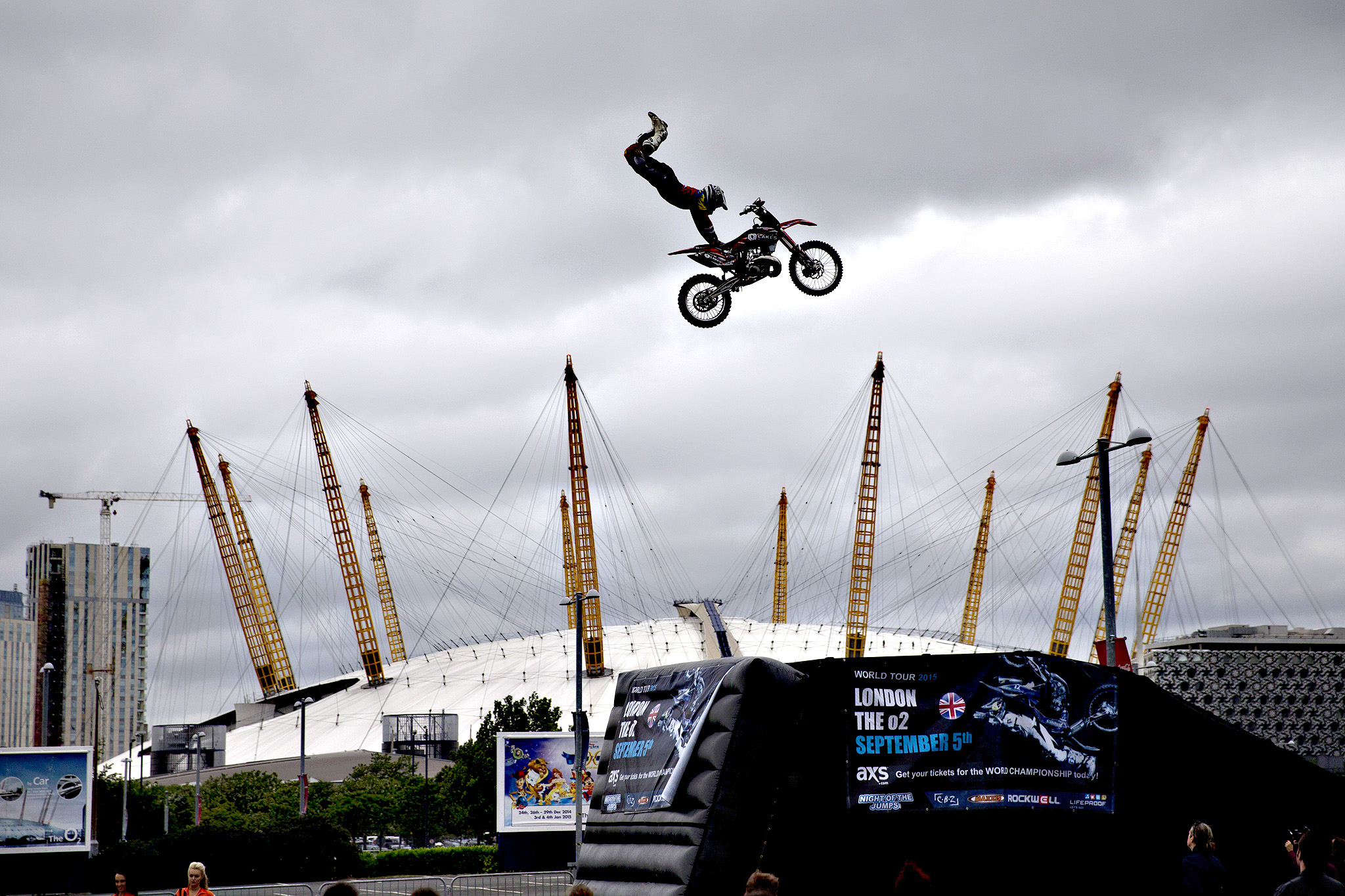 "Australia's Steve Sommerfeld performs a jump on his motocross bike backdropped by the O2 Arena during a promotional event in London, Tuesday, June 2, 2015.  The publicity stunt Tuesday was to promote the freestyle motocross world tour event ""Night of the Jumps"" which takes place inside the O2 Arena on September 5"