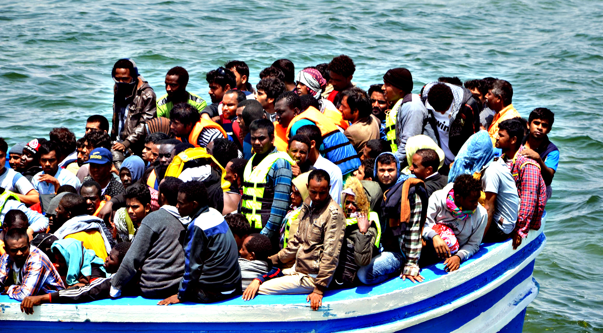 Migrants arrive at the port in the Tunisian town of Ben Guerdane, some 40 kilometres west of the Libyan border, following their rescue by Tunisia's coastguard and navy after their vessel overturned off Libya, on June 10, 2015. 354 migrants were rescued from two boats which broke down as they headed from Libya to Italy, the Red Crescent and an AFP correspondent said