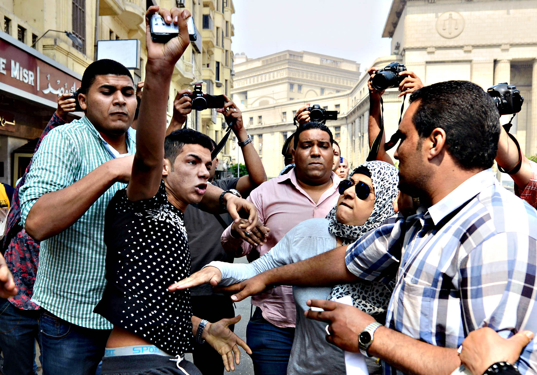 A young supporter of former Egyptian pre...A young supporter of former Egyptian president Hosni Mubarak (2nd L) is beaten up by an anti-Mubarak crowd outside the Court of Cassation in Cairo on June 4, 2015. An Egyptian appeals court will retry former president Hosni Mubarak over the deaths of hundreds of protesters during the 2011 uprising, after annulling a decision to drop murder charges against the former strongman.