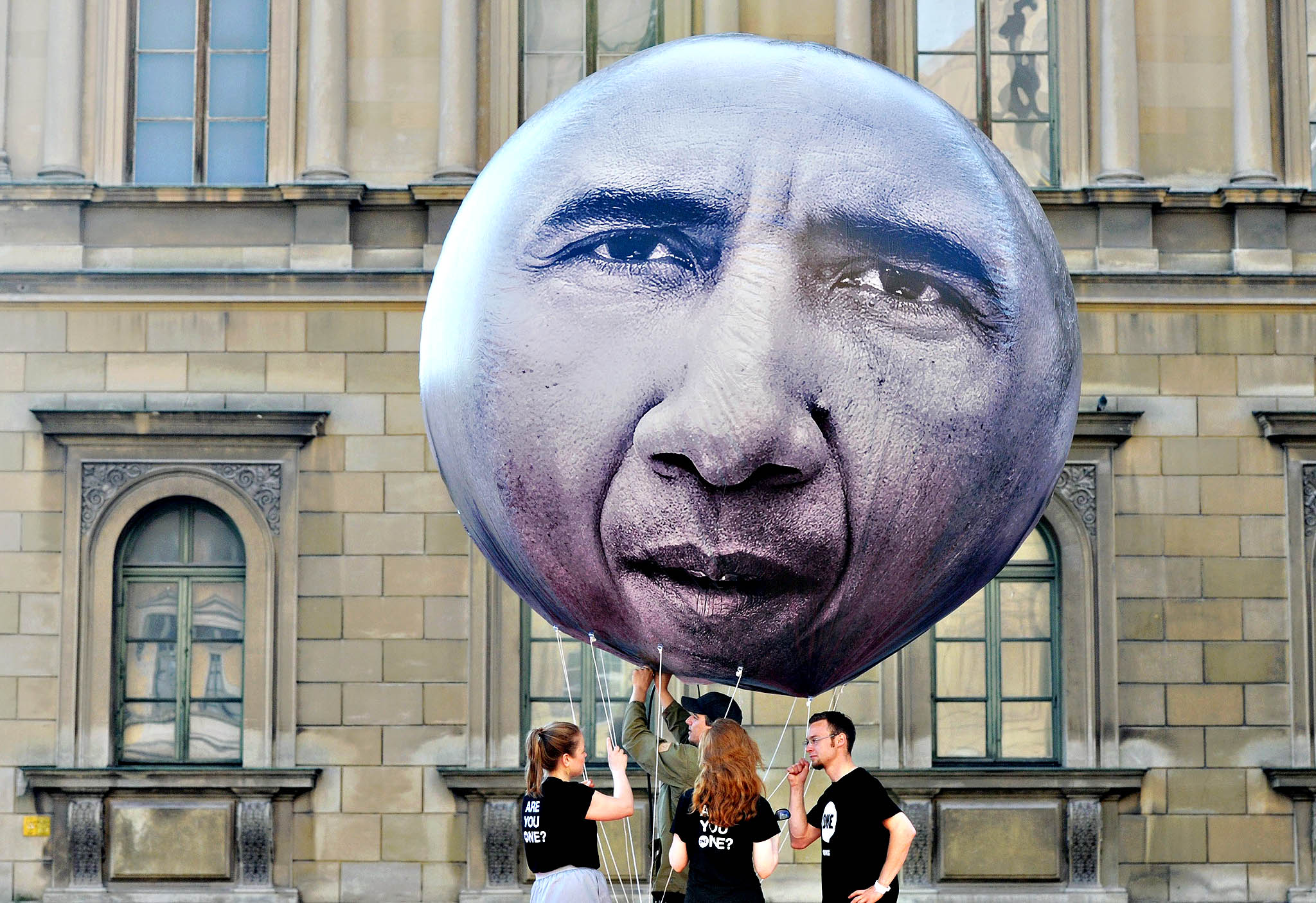 Helpers hold a balloon of the developmental advocacy and campaigning organisation 'ONE' depicting US President Barack Obama while it is filled with air on the Odeonsplatz in Munich, Germany, 05 June 2015. State and government leaders of the G7 countries are meeting on 07 and 08 June 2015 in Schloss Elmau near Garmisch-Partenkirchen
