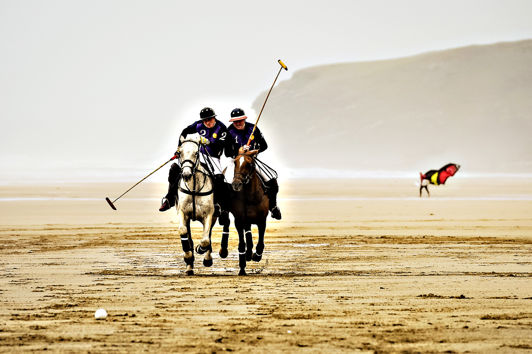 Polo on the Beach photocall...Polo players practice for the upcoming 'Polo on the Beach' match at Watergate Bay beach, Cornwall, in wet and windy conditions. PRESS ASSOCIATION Photo. Picture date: Tuesday June, 2, 2015