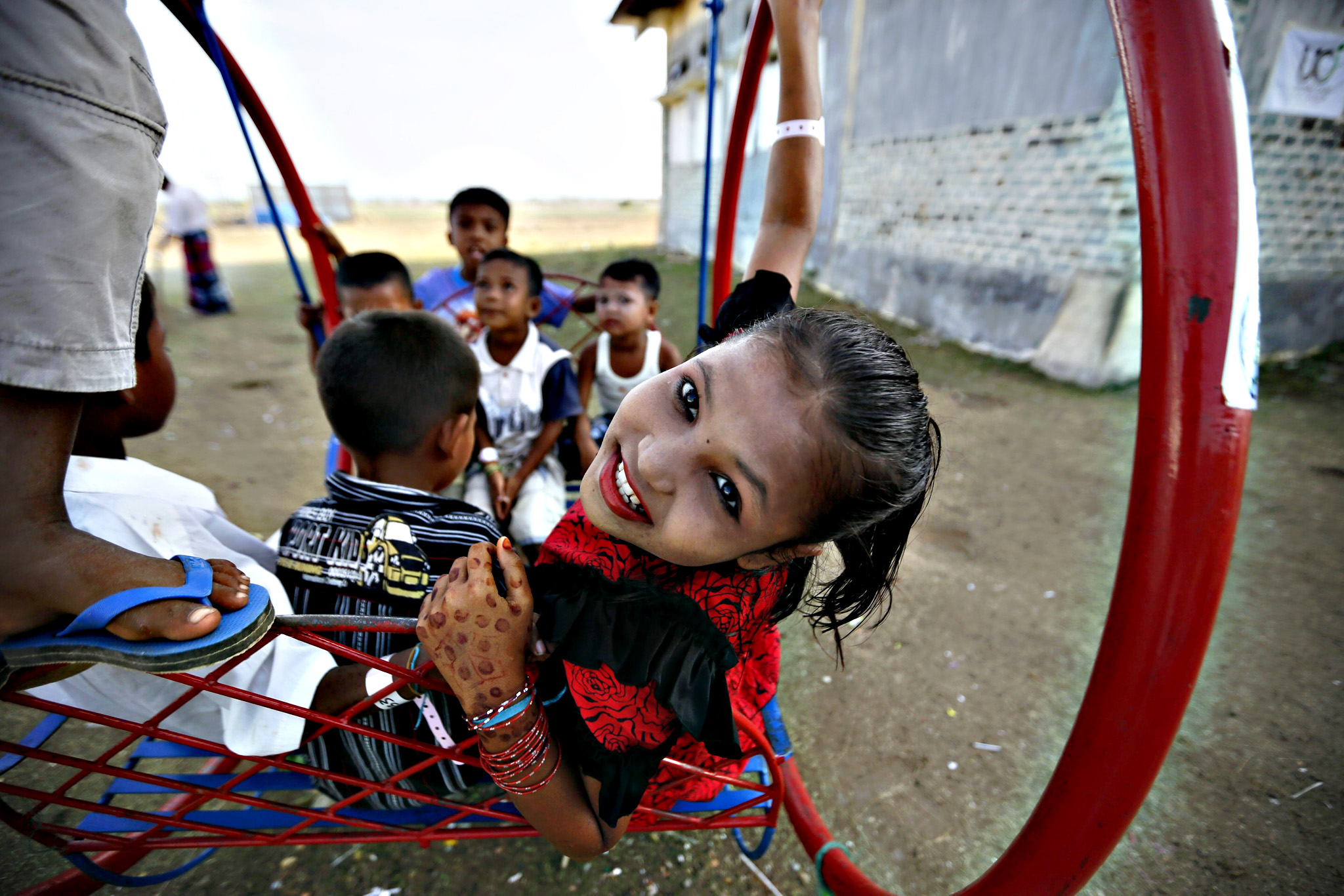 Rohingya refugee children play at their temporary camp in Kuala Cangkoi, North Aceh, Indonesia on Tuesday. The mostly Muslim Rohingya say they suffer discrimination in Myanmar, which does not recognize them as one of the official ethnic groups, and considers them to be illegal Bengali immigrants