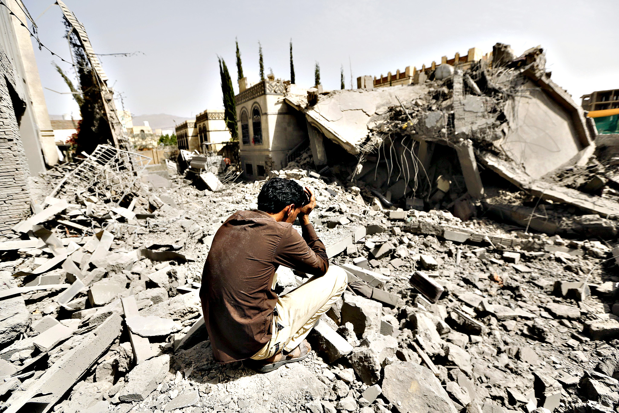 Guard sits on the rubble of the house of Brigadier Fouad al-Emad, an army commander loyal to the Houthis, after air strikes destroyed it in Sanaa, Yemen...A guard sits on the rubble of the house of Brigadier Fouad al-Emad, an army commander loyal to the Houthis, after air strikes destroyed it in Sanaa, Yemen June 15, 2015. Warplanes from a Saudi-led coalition bombarded Yemen's Houthi-controlled capital Sanaa overnight as the country's warring factions prepared for talks expected to start in Geneva on Monday