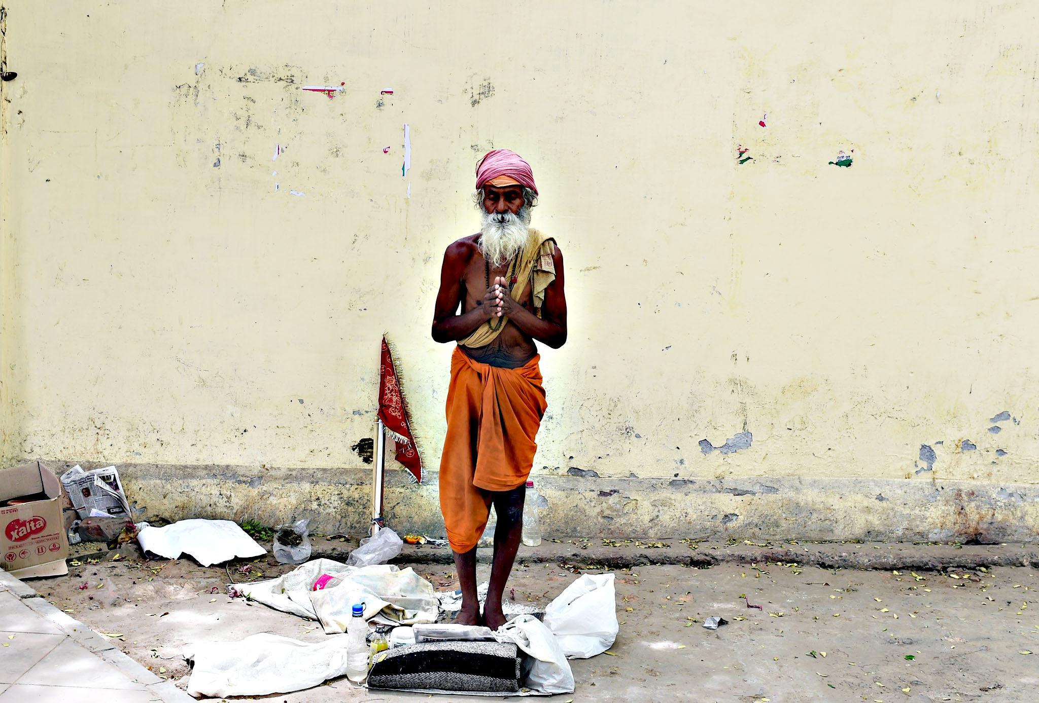 An Indian Sadhu (holy man) prays on the ...An Indian Sadhu (holy man) prays on the roadside in New Delhi on June 1, 2015.