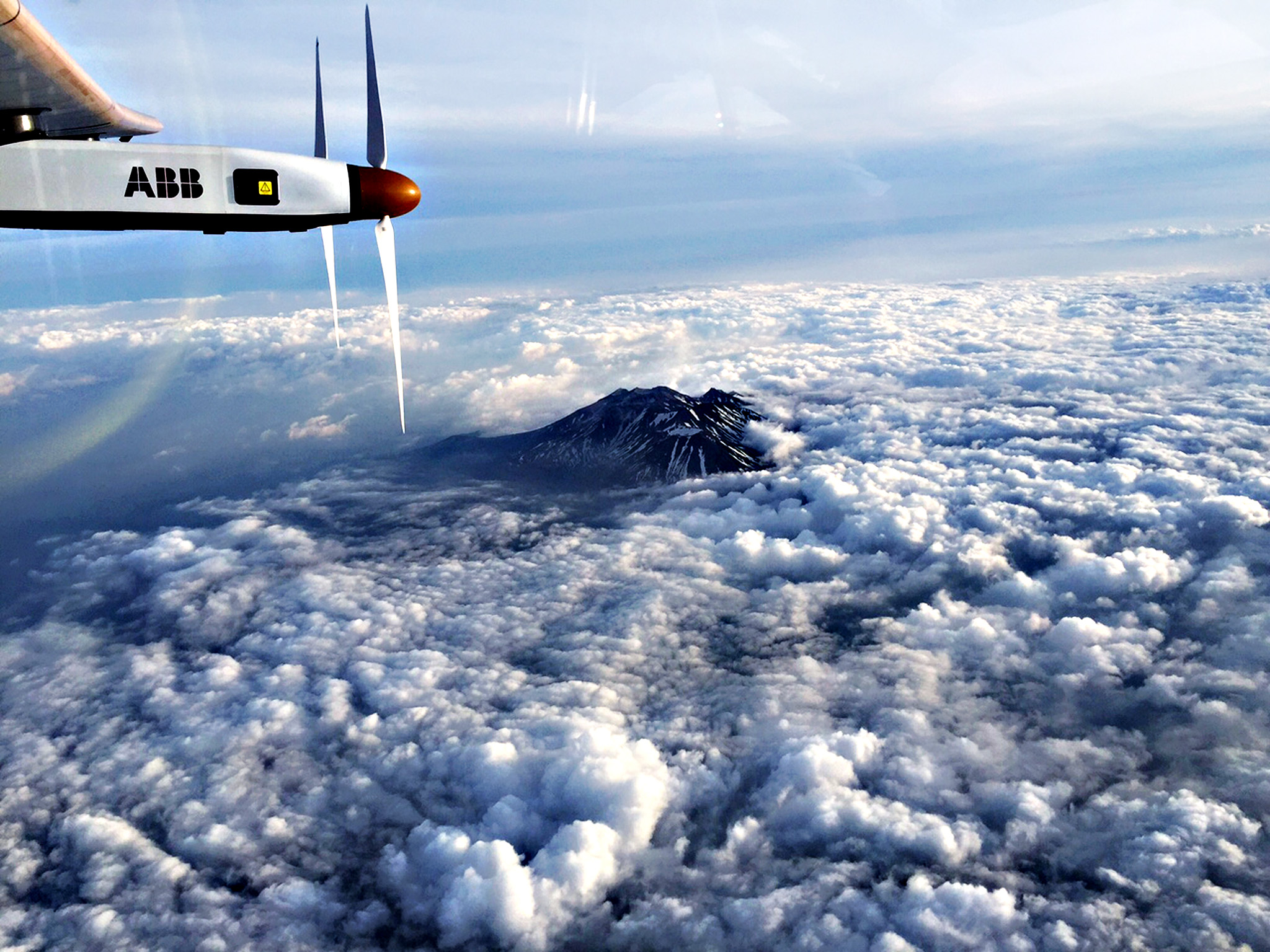 Picture taken by Solar Impulse 2 pilot Andre Borschberg shows a section of the solar powered plane as it flies over the Nagano mountain region in direction of Nagoya, Japan on June 1, 2015.  Solar Impulse 2 will land in the Japanese city of Nagoya, organisers said on June 1, 2015, as bad weather delayed a landmark attempt by a solar plane to cross the Pacific Ocean