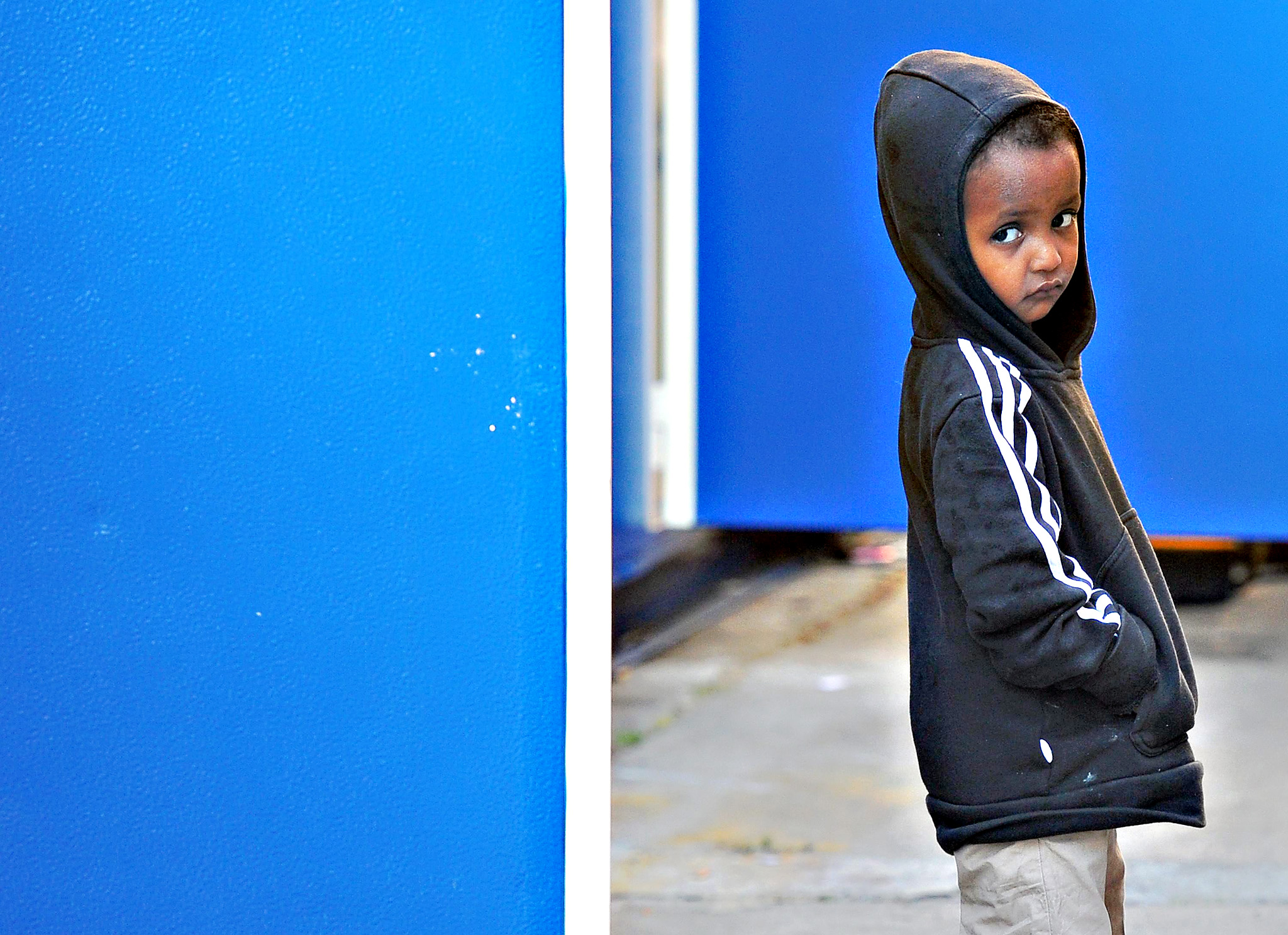 A migrant child walks a the train station of Ventimiglia, where stranded migrants are taking shelter, on the Italian border with France, Ventimiglia, Italy, 18 June 2015. The migrants, who wished to cross the border have been blocked by the French and Italian police. The European Commission has proposed the mandatory relocation of 40,000 Syrian and Eritrean asylum seekers from Italy and Greece to other EU nations over two years, to help take pressure off those two countries