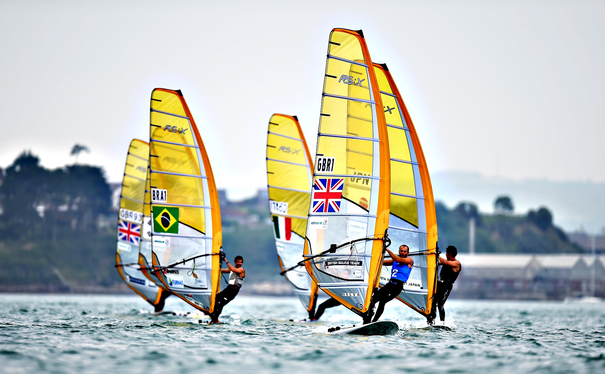 Great Britain's Nick Dempsey comes home to win the first race of the day during the Men's RS:X windsurfing on day five of the ISAF Sailing World Cup at Weymouth. PRESS ASSOCIATION Photo. Picture date Wednesday June 12, 2015.