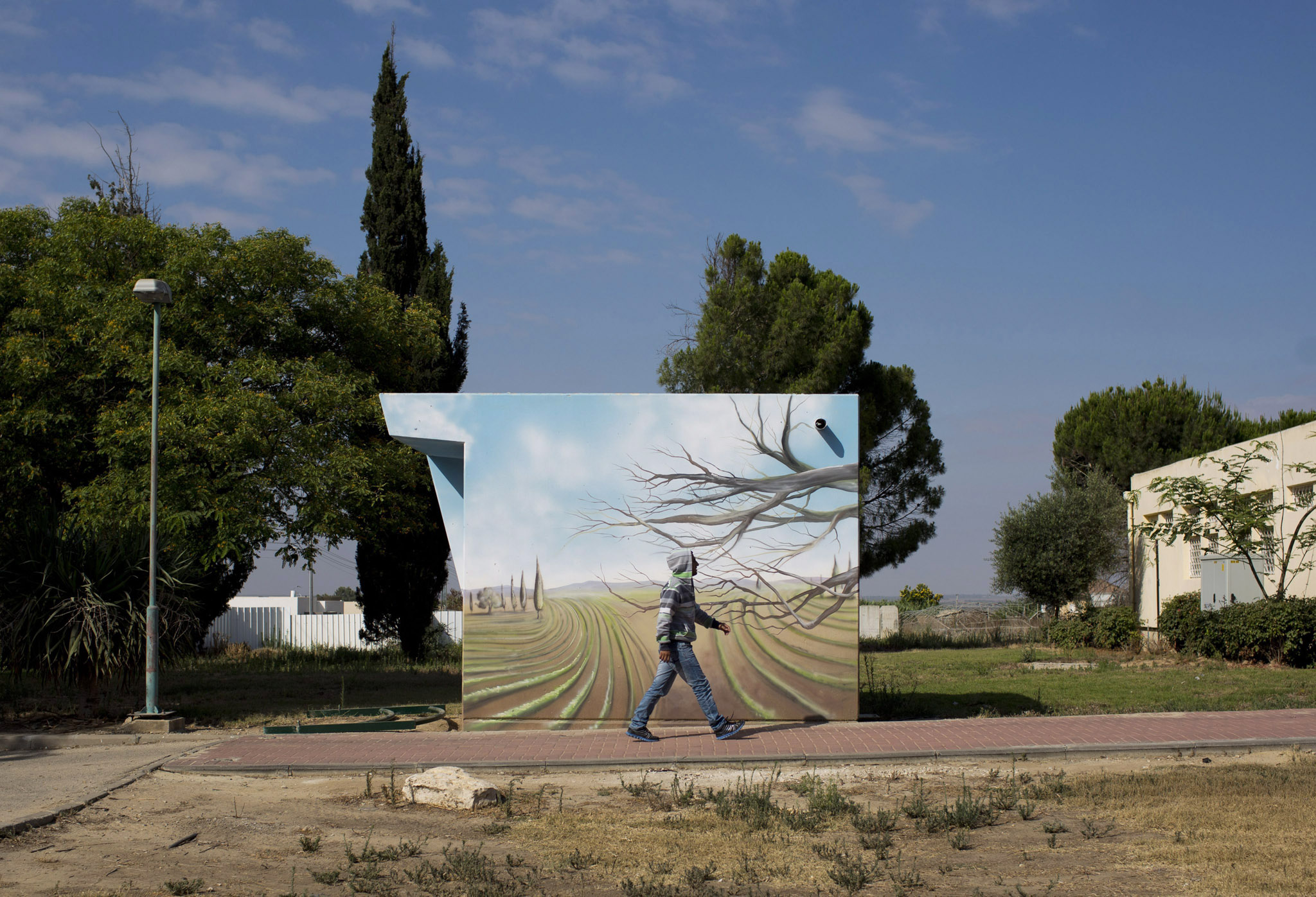 Israel marks one year since the 2014 Gaza conflict...epa04828836 (09/17) An Israeli man walks past a concrete protective shelter painted by Israeli artist Eliasaf Myara in the village of Shokeda, located a few kilometers from the border with the Gaza Strip, Israel, 25 June 2015. The Israeli Defense Ministry has placed hundreds of small concrete protective shelters to all towns located near the Gaza Strip to protect its citizens from incoming rockets. On 08 July 2015, Israel will mark one year since the 2014 IsraelñGaza conflict, also known as Operation Protective Edge.  EPA/ABIR SULTAN PLEASE REFER TO THE ADVISORY NOTICE (epa04828827) FOR FULL PACKAGE TEXT