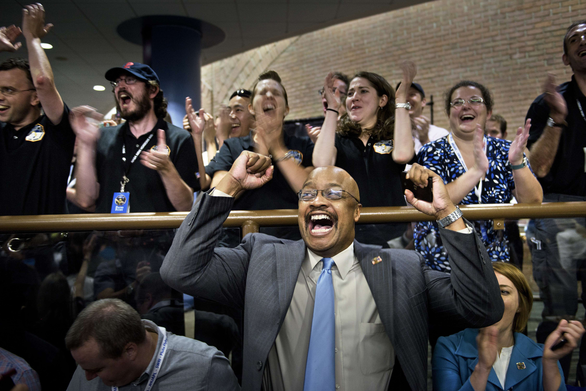 TOPSHOTS NASA and project staff react wi...TOPSHOTS NASA and project staff react with others as telemetry is received from the New Horizons probe at the Johns Hopkins University Applied Physics Laboratory in Laurel, Maryland on July 14, 2015. The New Horizons interplanetary space probe reestablished contact with NASA after safe passage completing its closest approach fly-by of Pluto making the United States the first to explore the dwarf planet. AFP PHOTO/BRENDAN SMIALOWSKIBRENDAN SMIALOWSKI/AFP/Getty Images