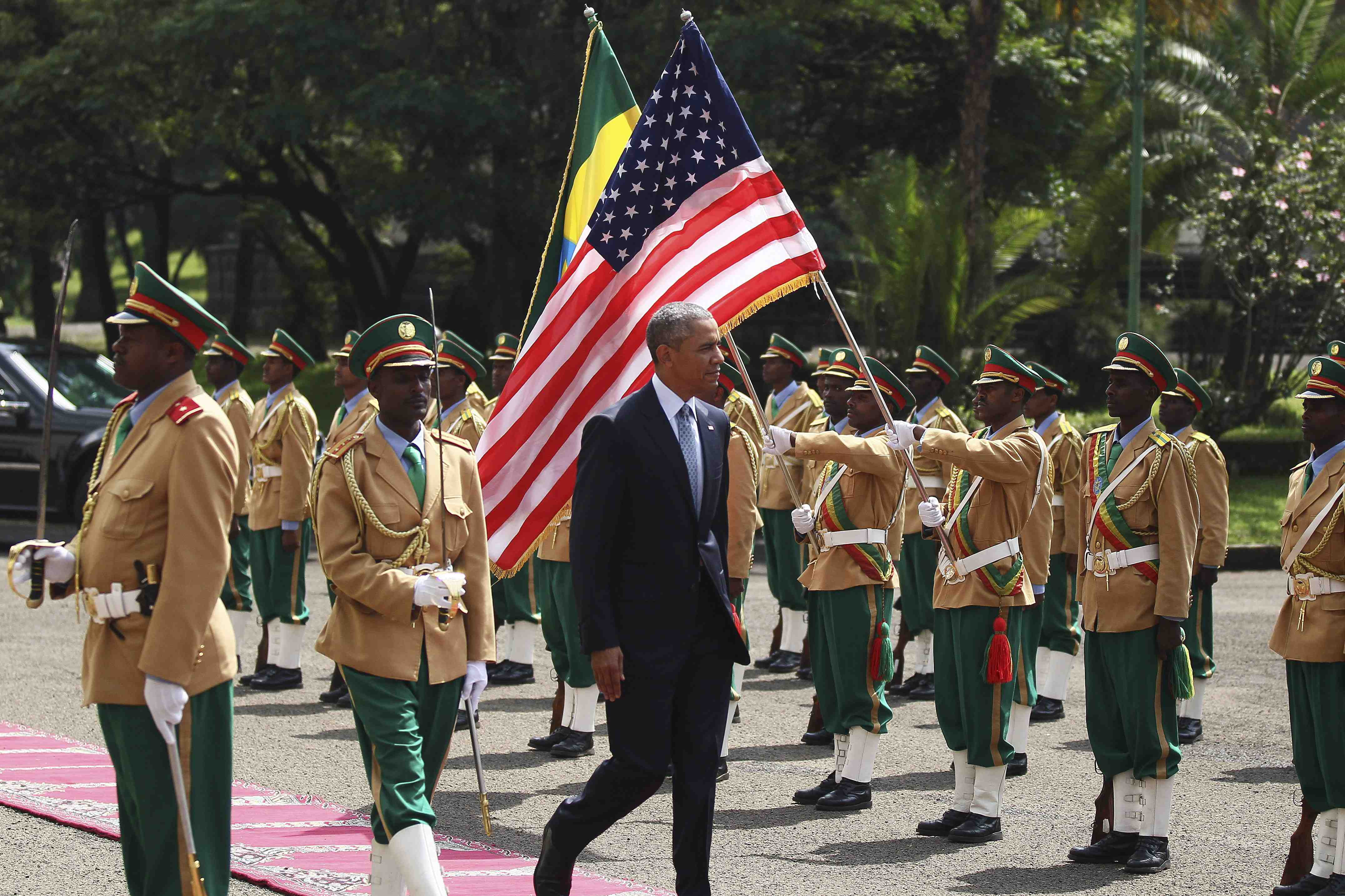 U.S. President Barack Obama (C) reviews a marsh band during a welcome ceremony at the National Palace in Addis Ababa, Ethiopia July 27, 2015