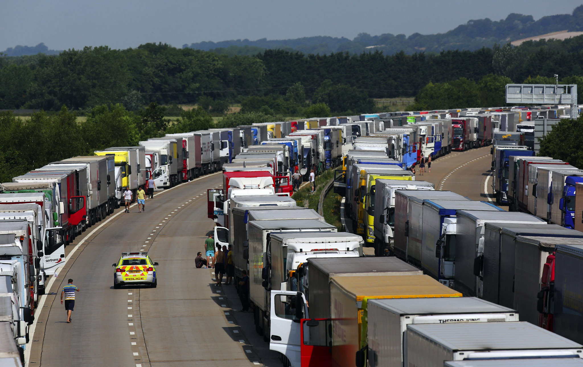 Lorries parked on both carriageways of the M20 in Ashford, Kent, as Operation Stack remains in place due to industrial action in Calais on what is predicted to be the hottest day of the year so far.