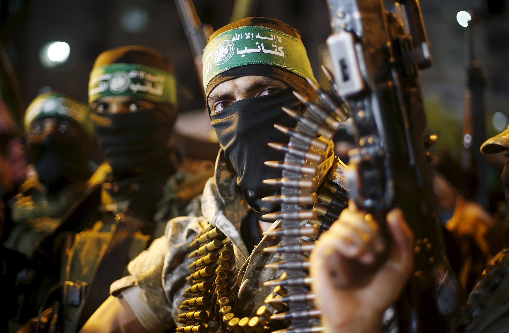 Palestinians Hamas militants march during an anti-Israel rally in Gaza City