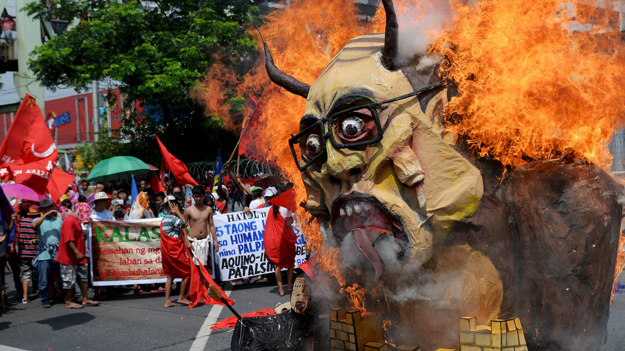 Protesters burn an effigy of President Aquino during a rally near Batasang Pambansa in Quezon city