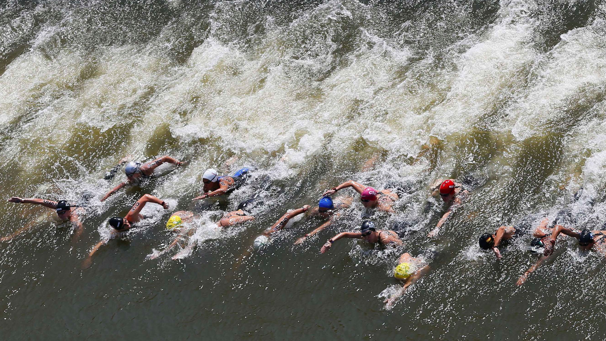 Swimmers start the women's 10km open water race at the Aquatics World Championships in Kazan, Russia.