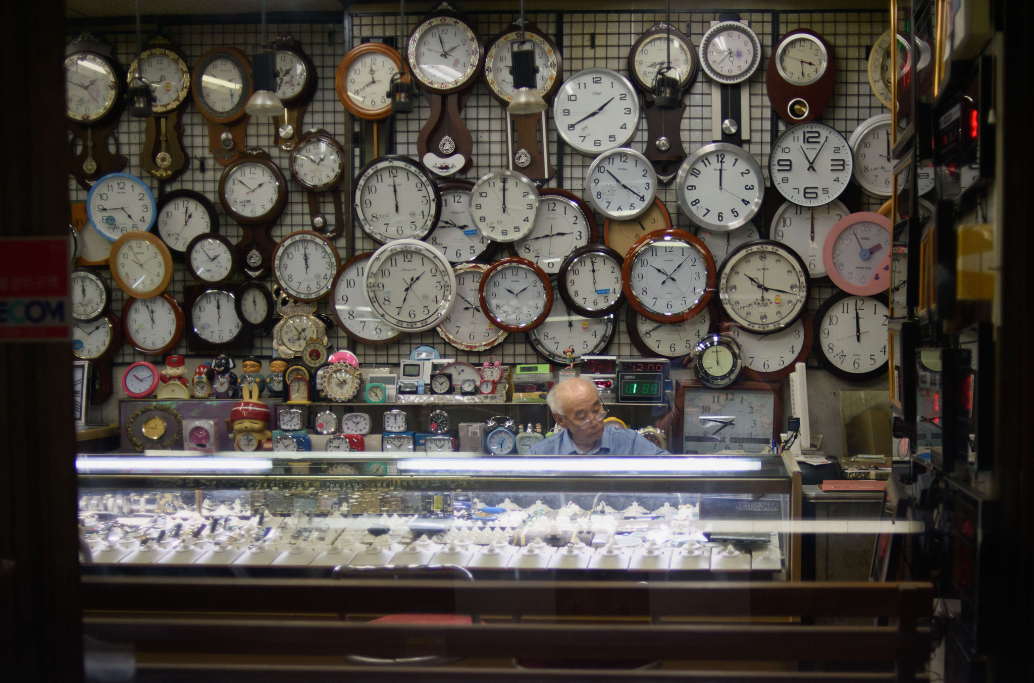 A watch and clock vendor sits in his shop in Seoul, South Korea.
