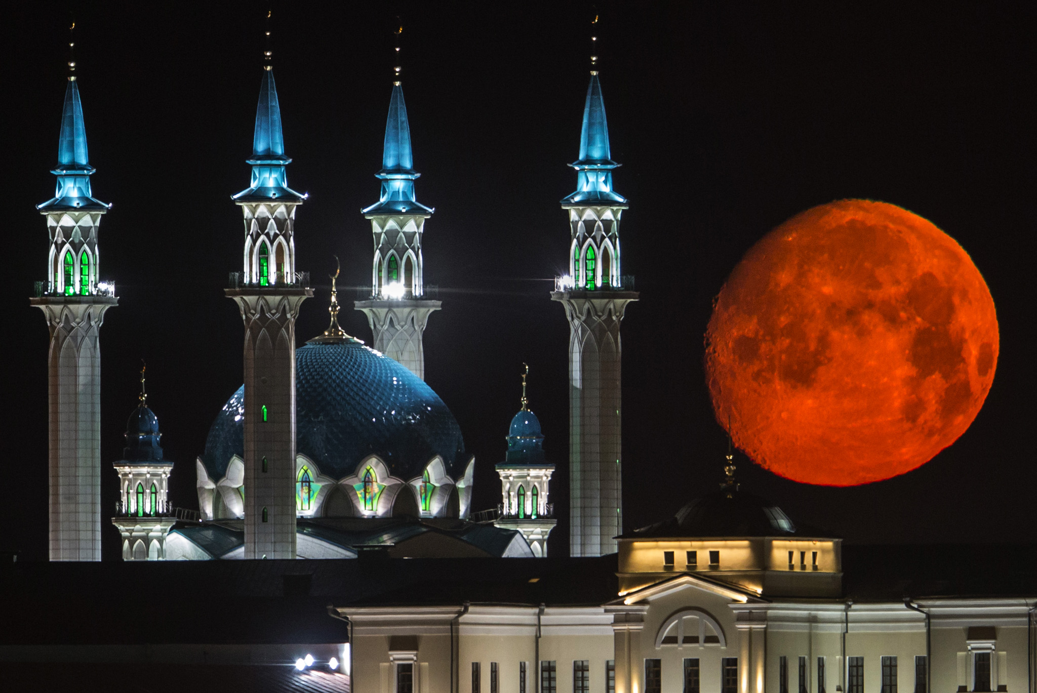 The full moon rises over the illuminated Kazan Kremlin and Qol Sharif mosque in Kazan, the capital of Tatarstan, located in Russia's Volga River area.