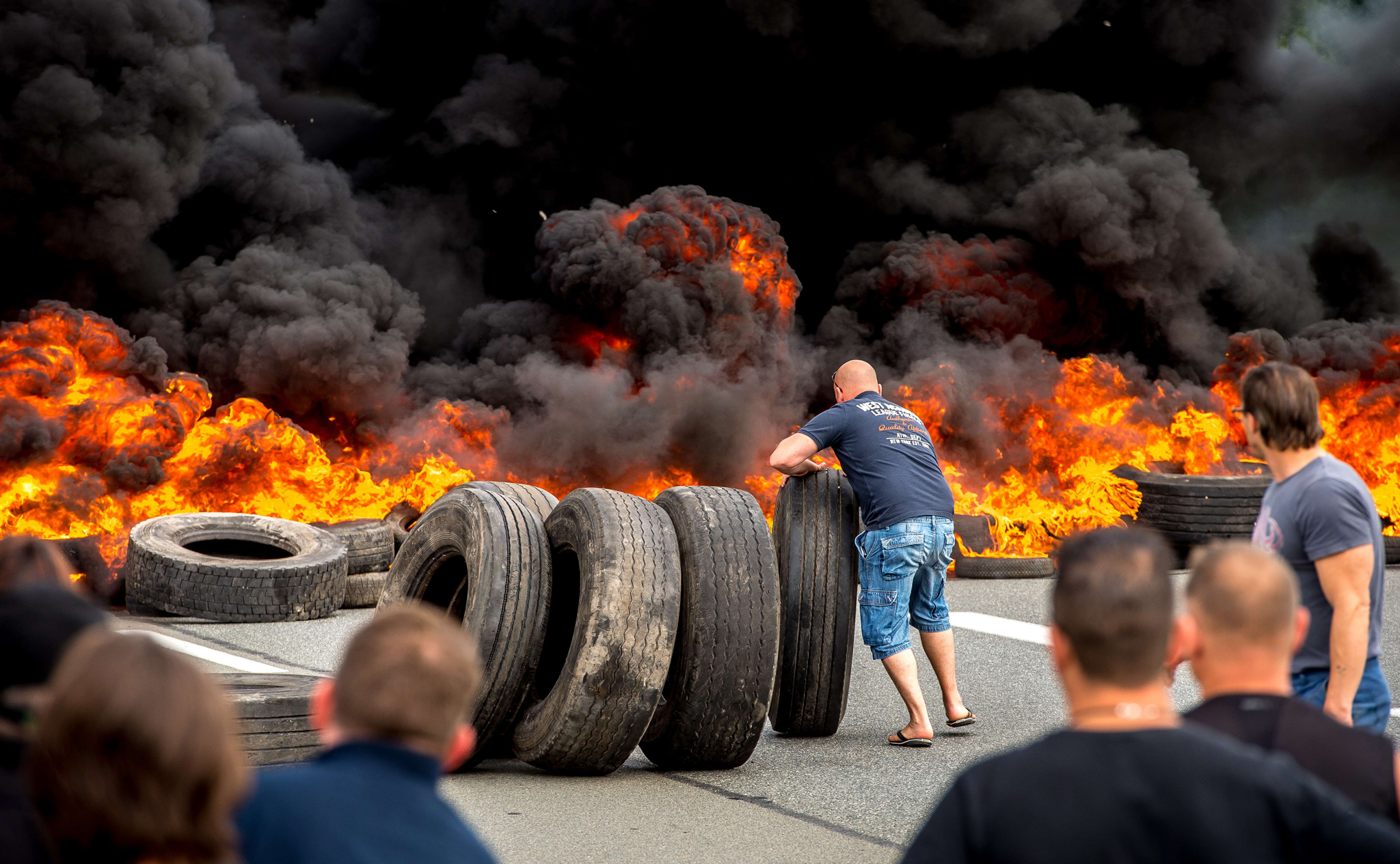 Striking employees of the My Ferry Link company block the access to Calais harbour with burning tyres following the failure of negotiations with French government concerning job cuts.