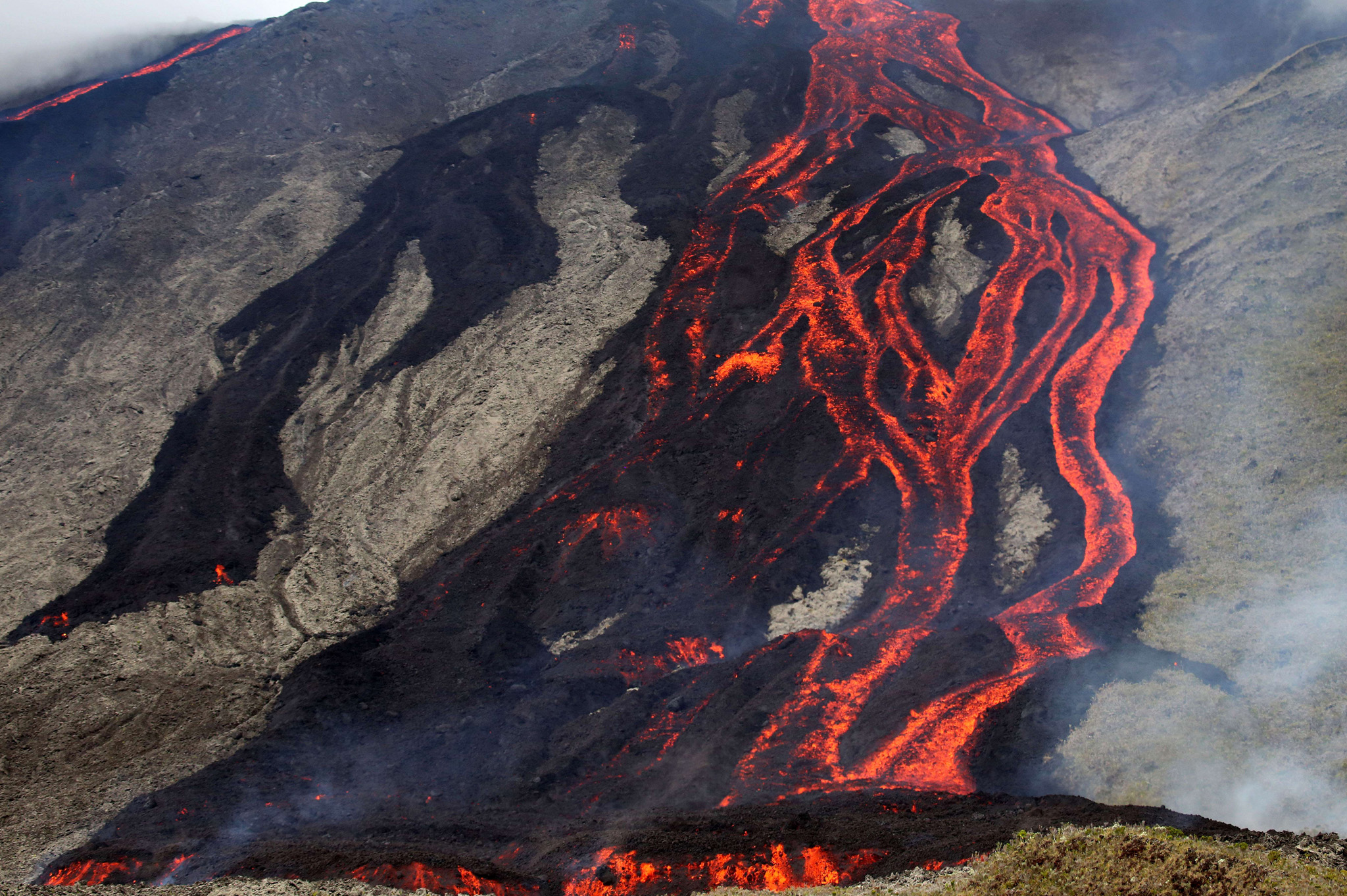 Lava flows out of the Piton de la Fournaise volcano as it erupts on the French island of La Reunion in the Indian Ocean.