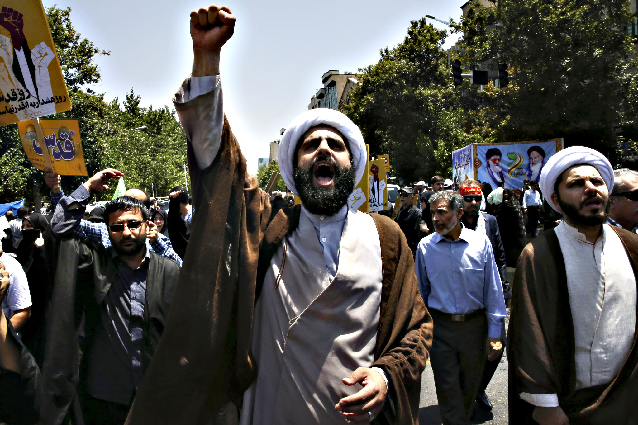 "An Iranian clergyman chants slogan in an annual pro-Palestinian rally marking Al-Quds (Jerusalem) Day at the Enqelab-e-Eslami (Islamic Revolution) St. in Tehran, Iran, Friday, July 10, 2015. Tens of thousands of Iranians took part in an annual pro-Palestinian rally marched in Tehran, chanting ""Down with America"" and ""Death to Israel."" Iran does not recognize Israel and since the 1979 Islamic Revolution has observed Al-Quds Day"