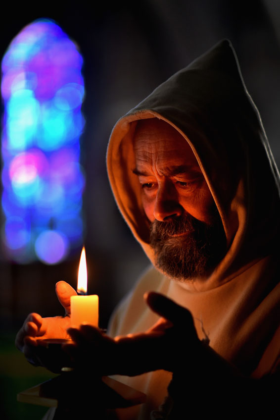 Abbey's Tranquility Is Under Threat From Proposed New Road...ELGIN, SCOTLAND - JULY 21:  Father Giles Conacher lights a candle in the lady chapel at Pluscarden Abbey on July 21, 2015 in Elgin, Scotland. Monks at Abbey which owes its foundation to King Alexander II of Scotland in the year 1230, are warning their peaceful way of life will be threatened if a possible route for a new dual carriageway linking the A96 road between Forres and Fochabers will run close to their retreat near Elgin.  (Photo by Jeff J Mitchell/Getty Images)