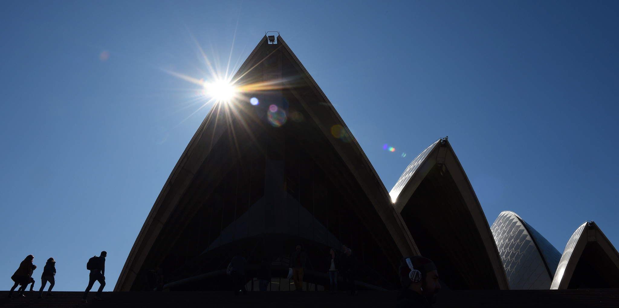 People visit the iconic Sydney Opera Hou...People visit the iconic Sydney Opera House on a winters day on July 15, 2015. AFP PHOTO / Peter PARKSPETER PARKS/AFP/Getty Images
