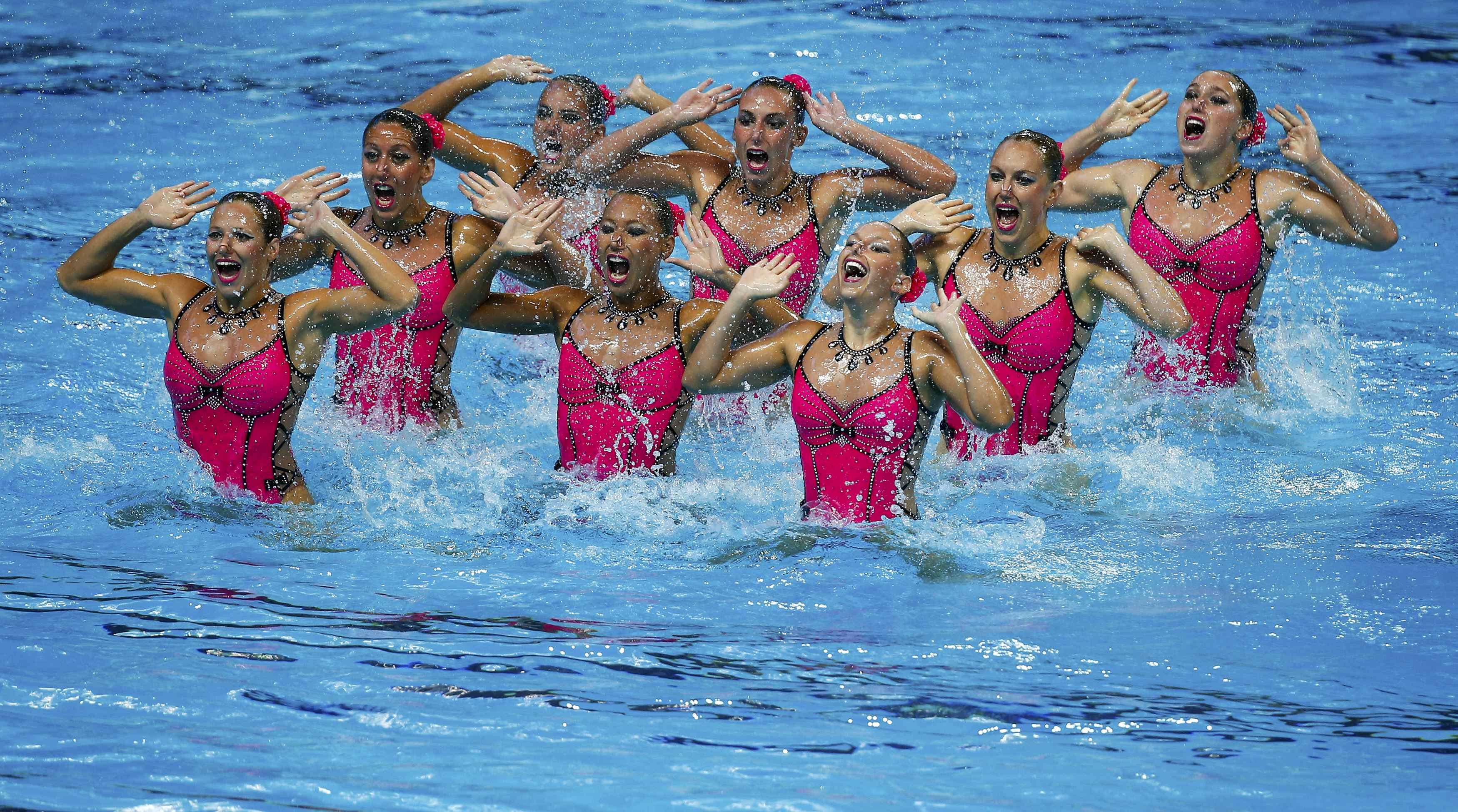 Members of Team France perform in the synchronised swimming team technical final at the Aquatics World Championships in Kazan, Russia July 27, 2015.